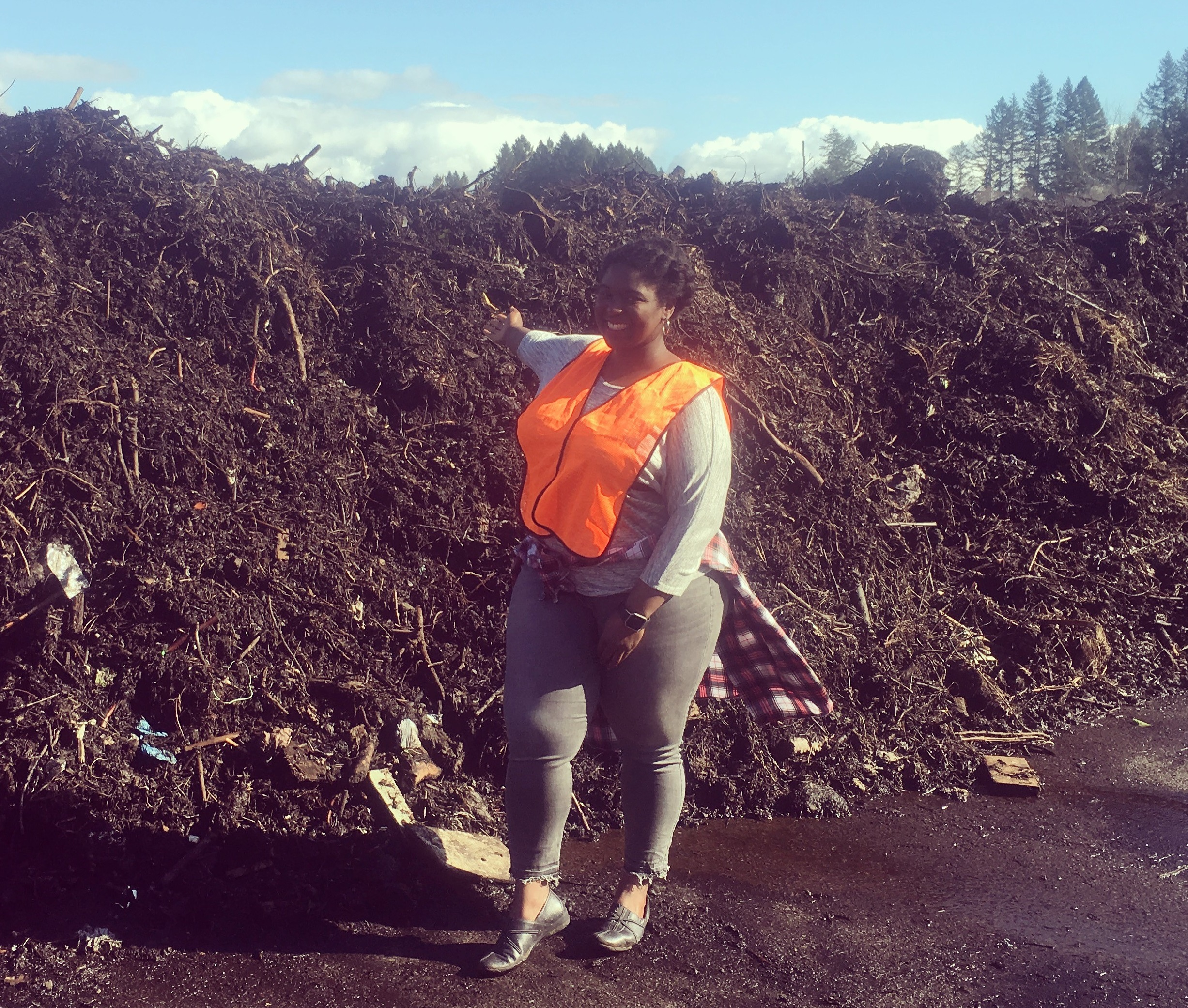 Janine shows her enthusiams for compost at Nature's Needs Compost facility