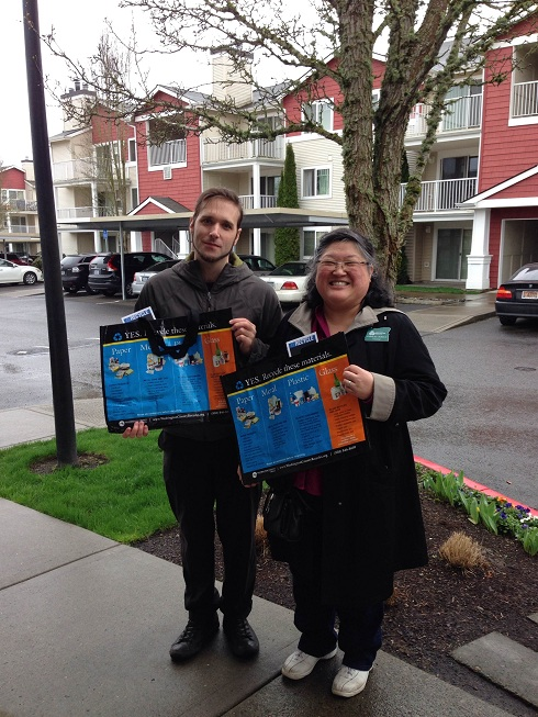 Nick and Francis demonstrate bags for residents to collect materials and carry them to centralized recycling.