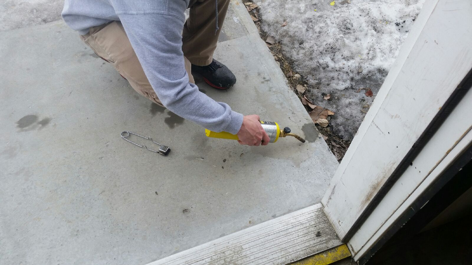 STEP 1:     Clean surface with appropriate cleaner or solvent and let it dry fully.    *Apply product in temperatures above 50 degrees Fahrenheit/10 degrees Celsius.    *  Use appropriate degreaser/cleaner to keep material and surrounding surfaces free of debris and grease.    *In this application, a torch was used to help remove excess moisture from dam p concrete.