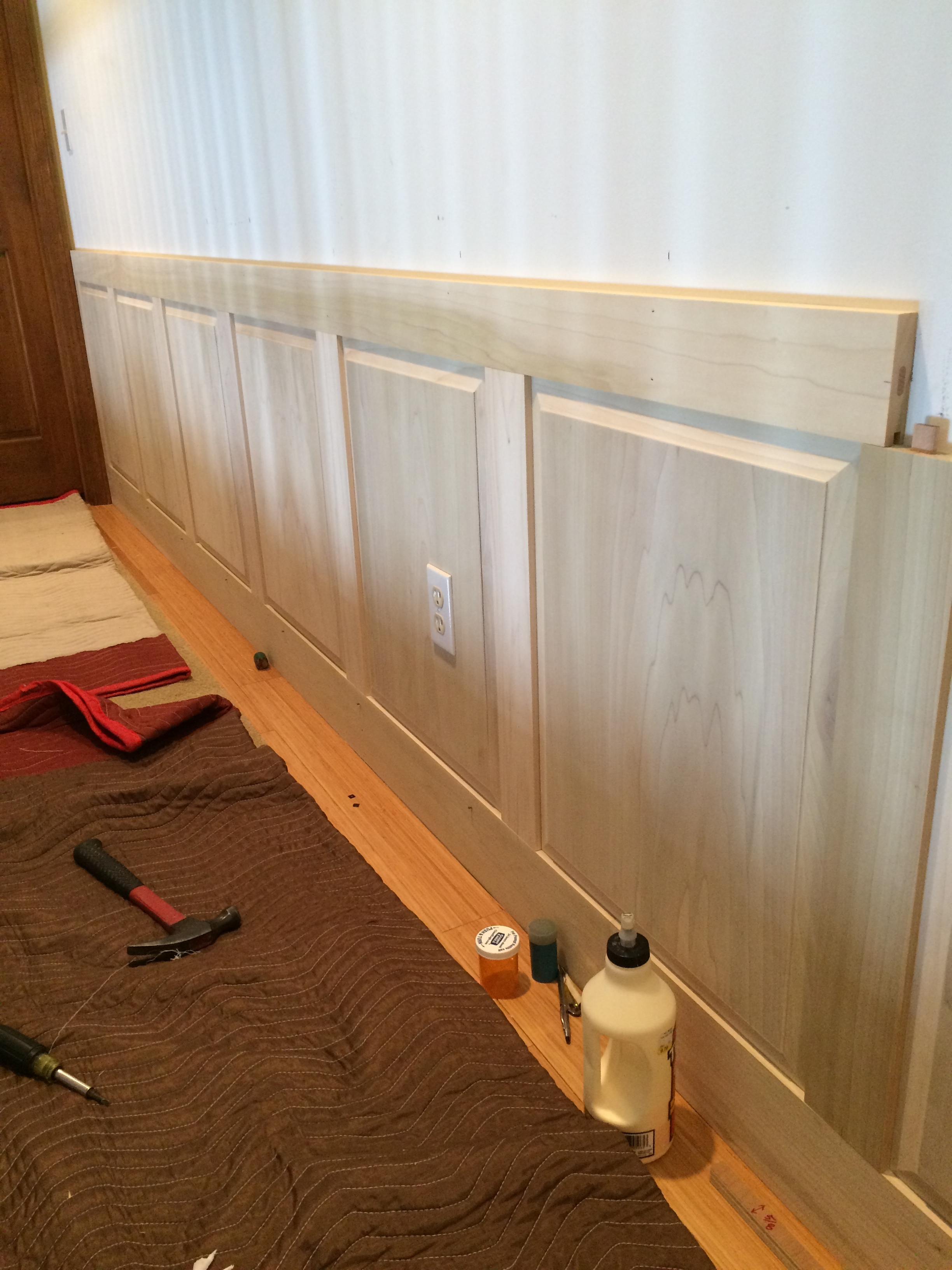 Panels are sized to the wall to ensure electrical boxes are in the flat of the panel.