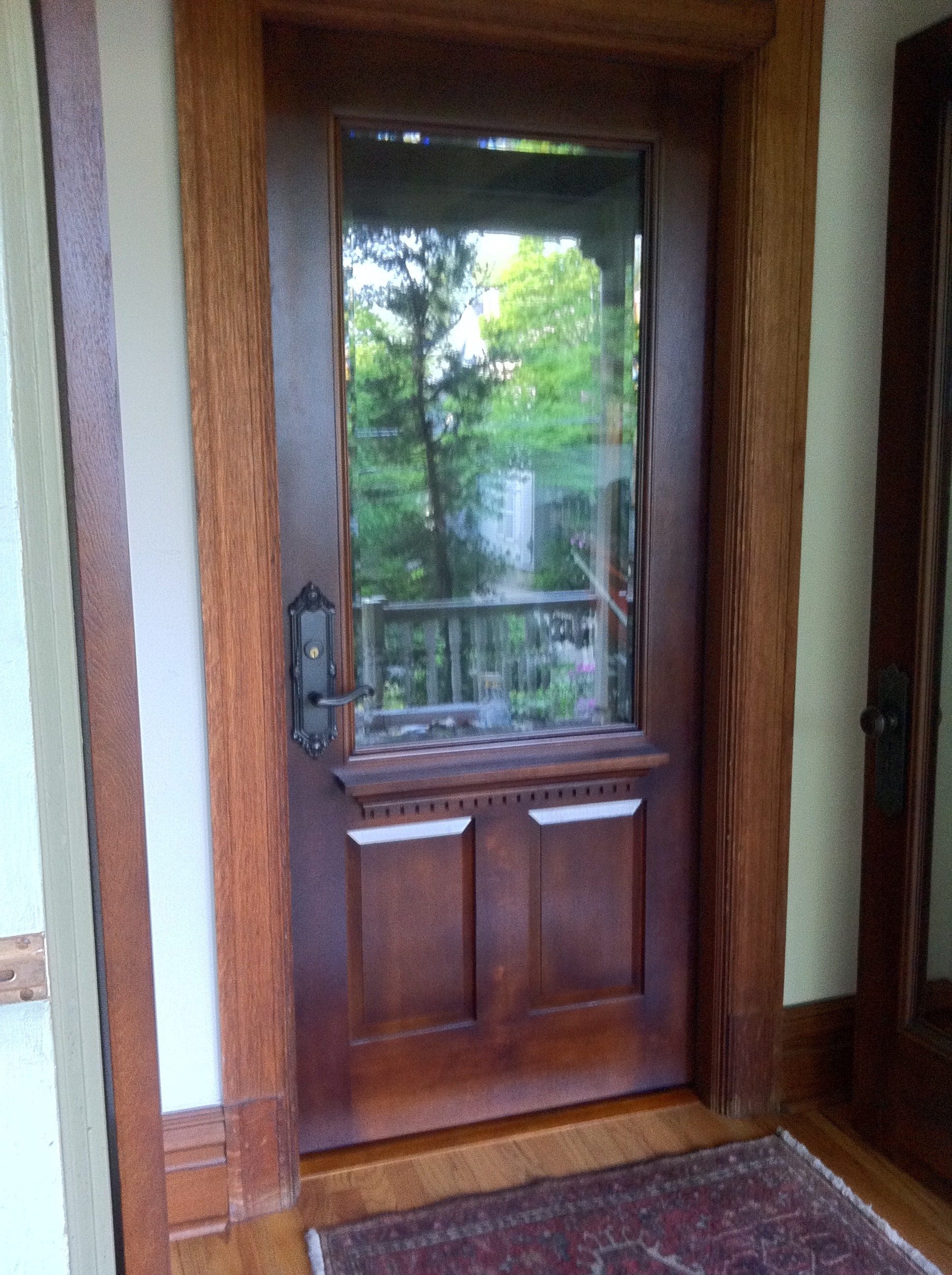 Qt. sawn white oak with insulated beveled glass unit.