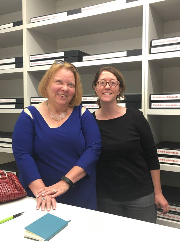 Kim A Munson (left) with Archivist Heather Strelecki at the archives of the American Institute of Graphic Arts in New York, 2017.