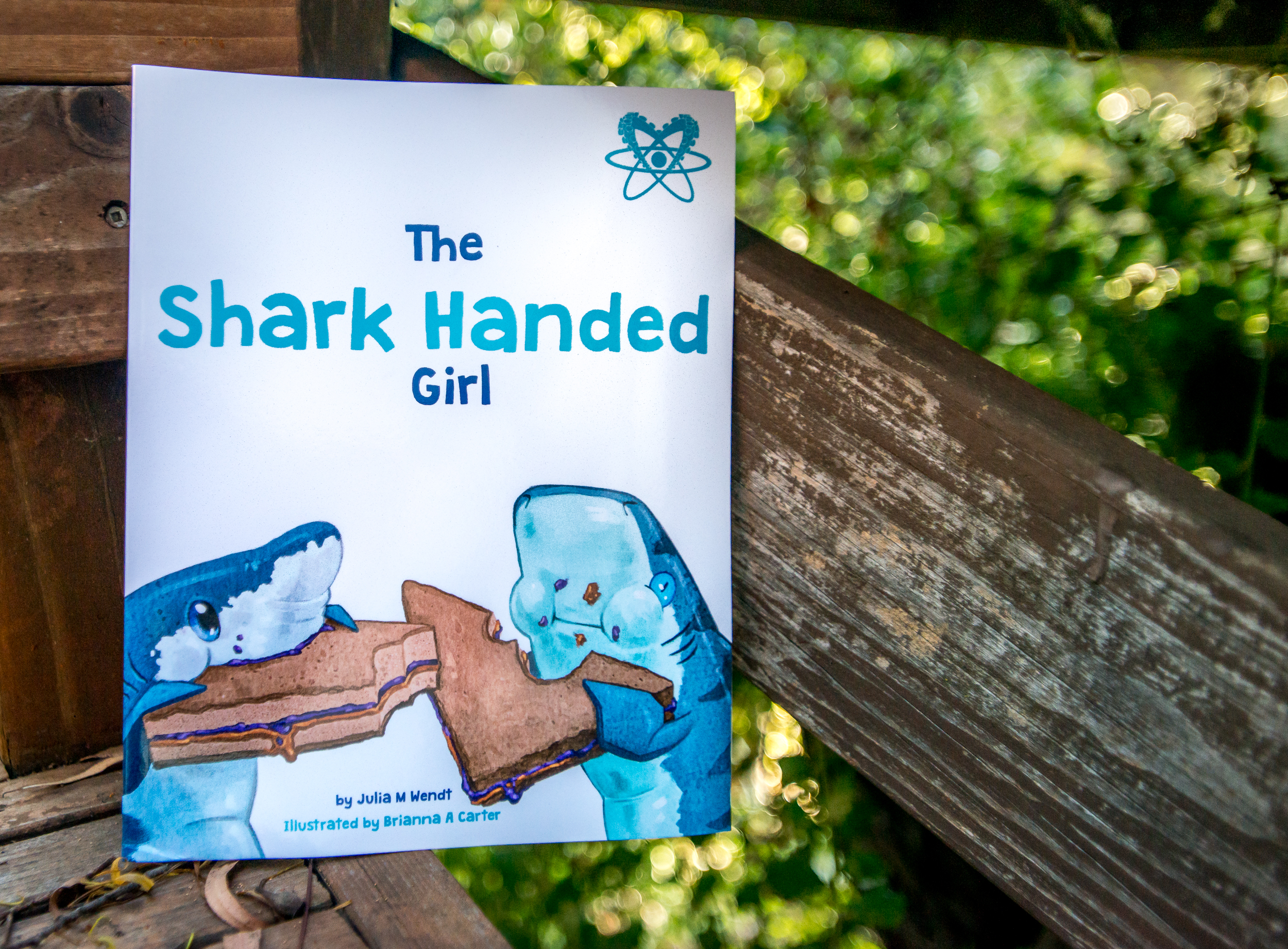 Julia's debut children's book, The Shark Handed Girl, illustrated by Brianna A. Carter