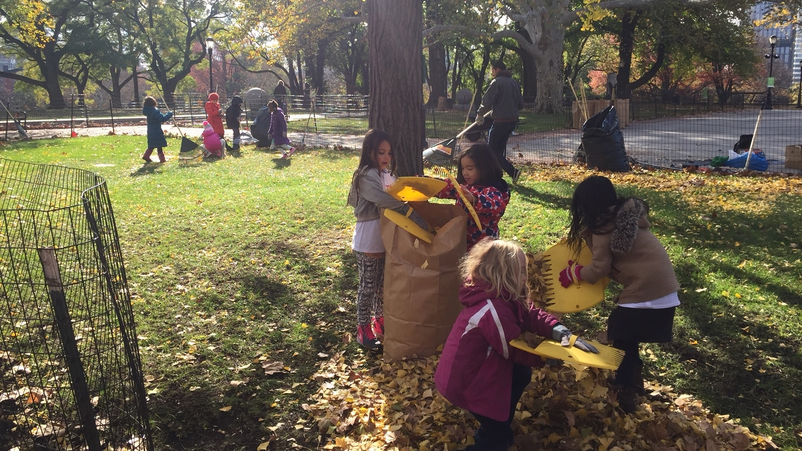 Volunteers from a local school group tending Monument Greene as part of a service learning day.