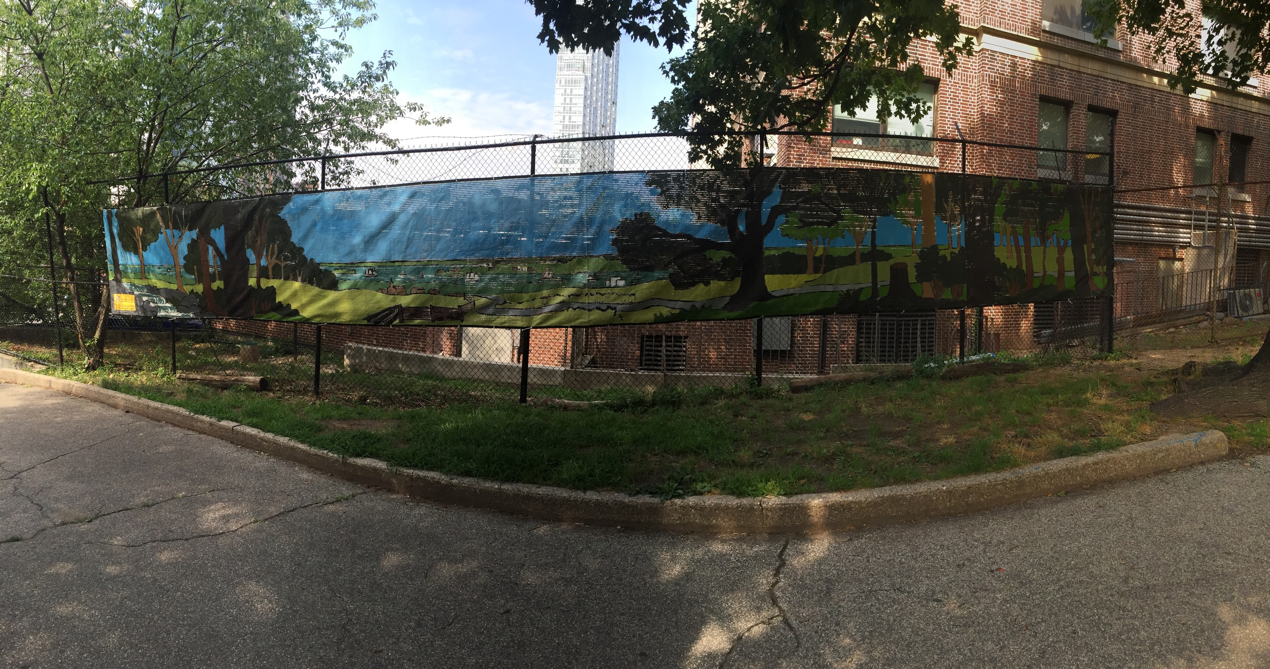 The finished mural hangs proudly between the hospital and Fort Greene Park