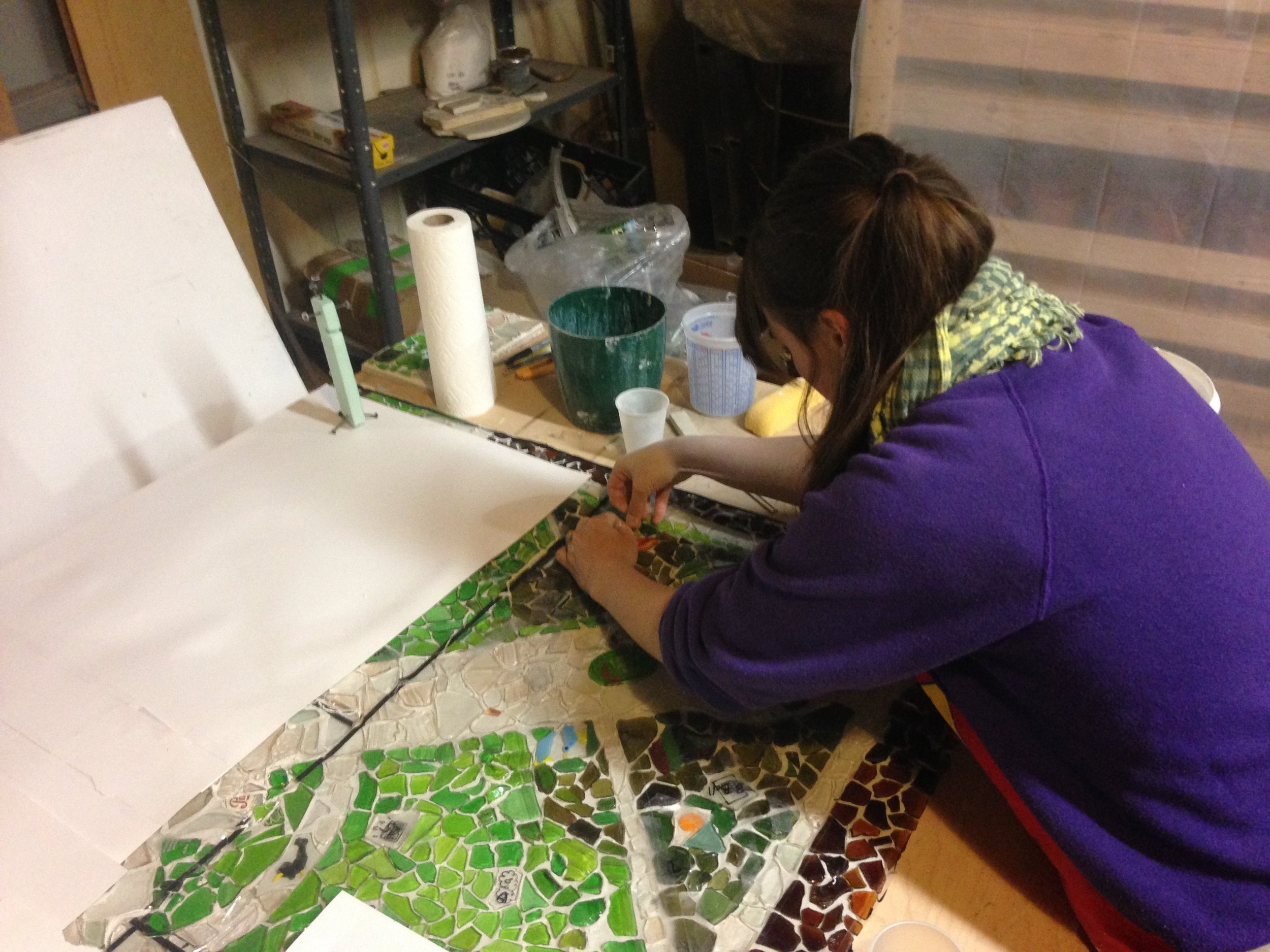 Amanda Patenaude at work, arranging the glass fragments to form a map of the park.