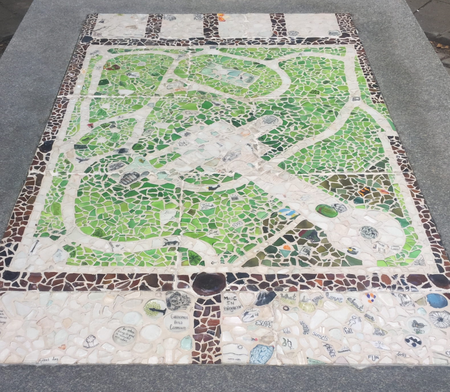"""Amanda Patenaude's """"One Map of Many Moments"""" glass mosaic, installed through May 2018 in the west wing of the Monument Plaza,turns a long-standing park maintenance challenge into an opportunity for community engagement and placemaking."""