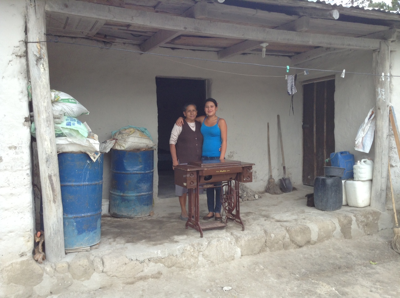 with her mother when her sewing machine was delivered to her home