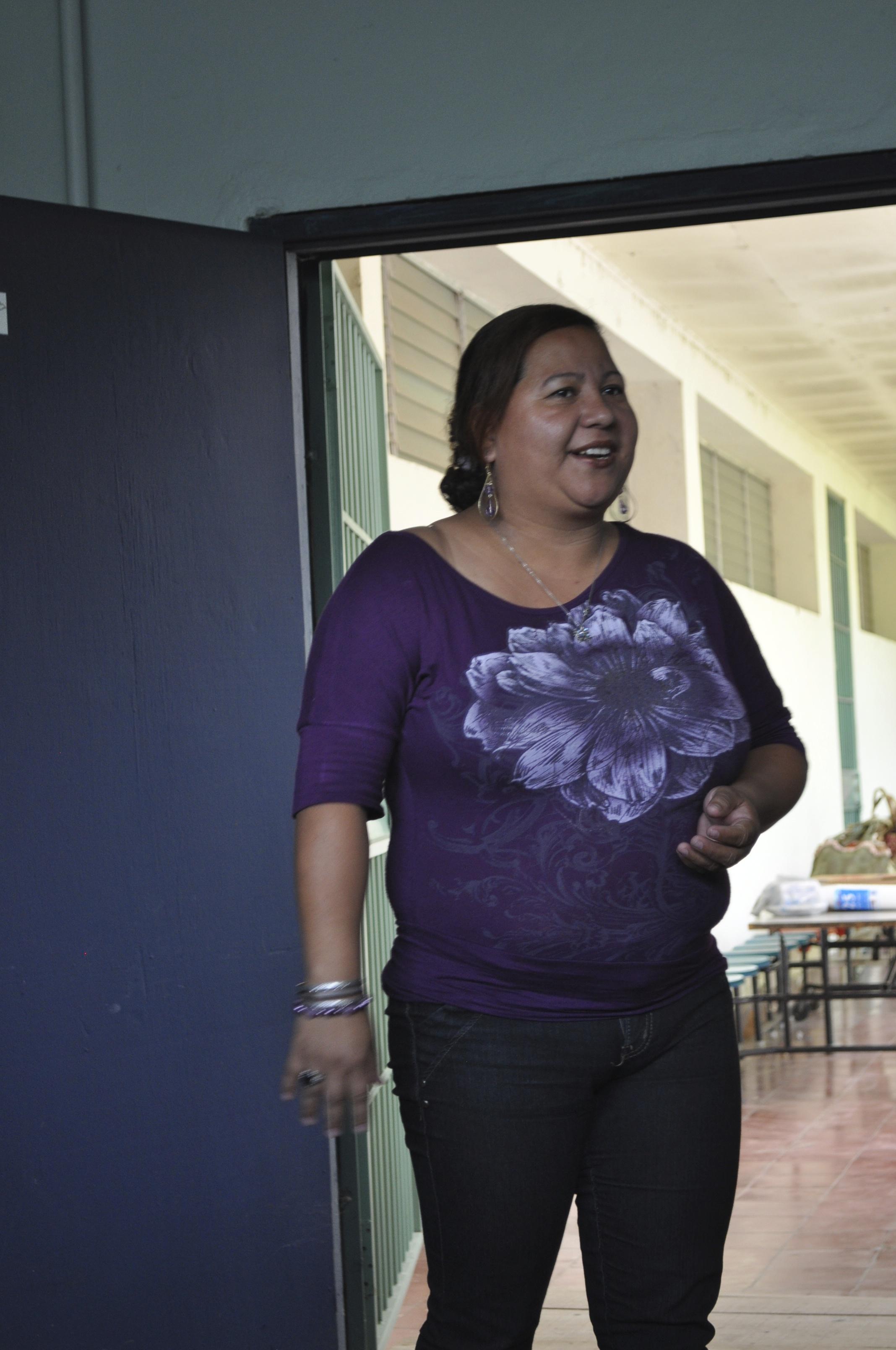 Gabriela speaking to a graduating class at Mi Esperanza 2013