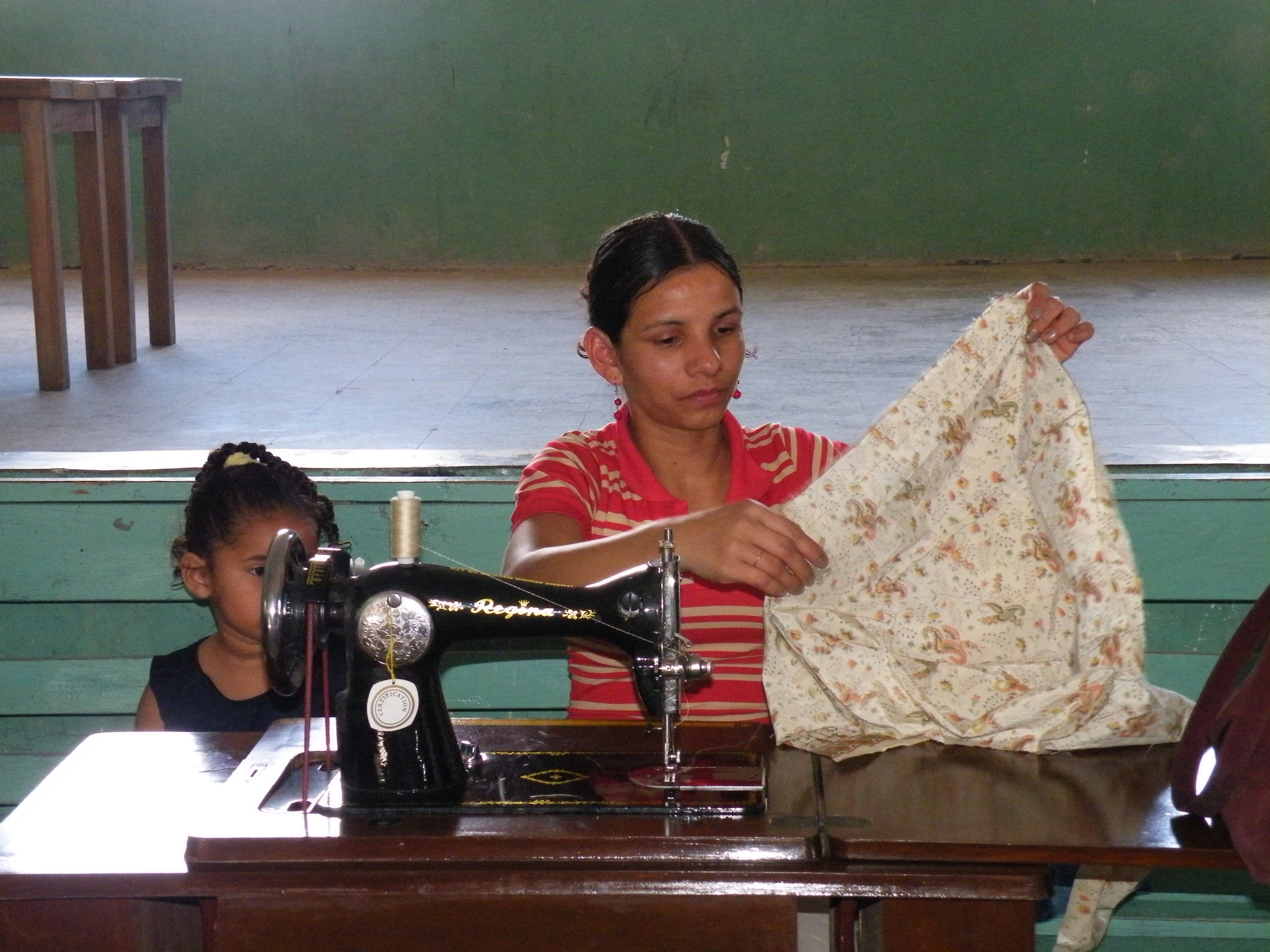 Student with her child close by while working in class.