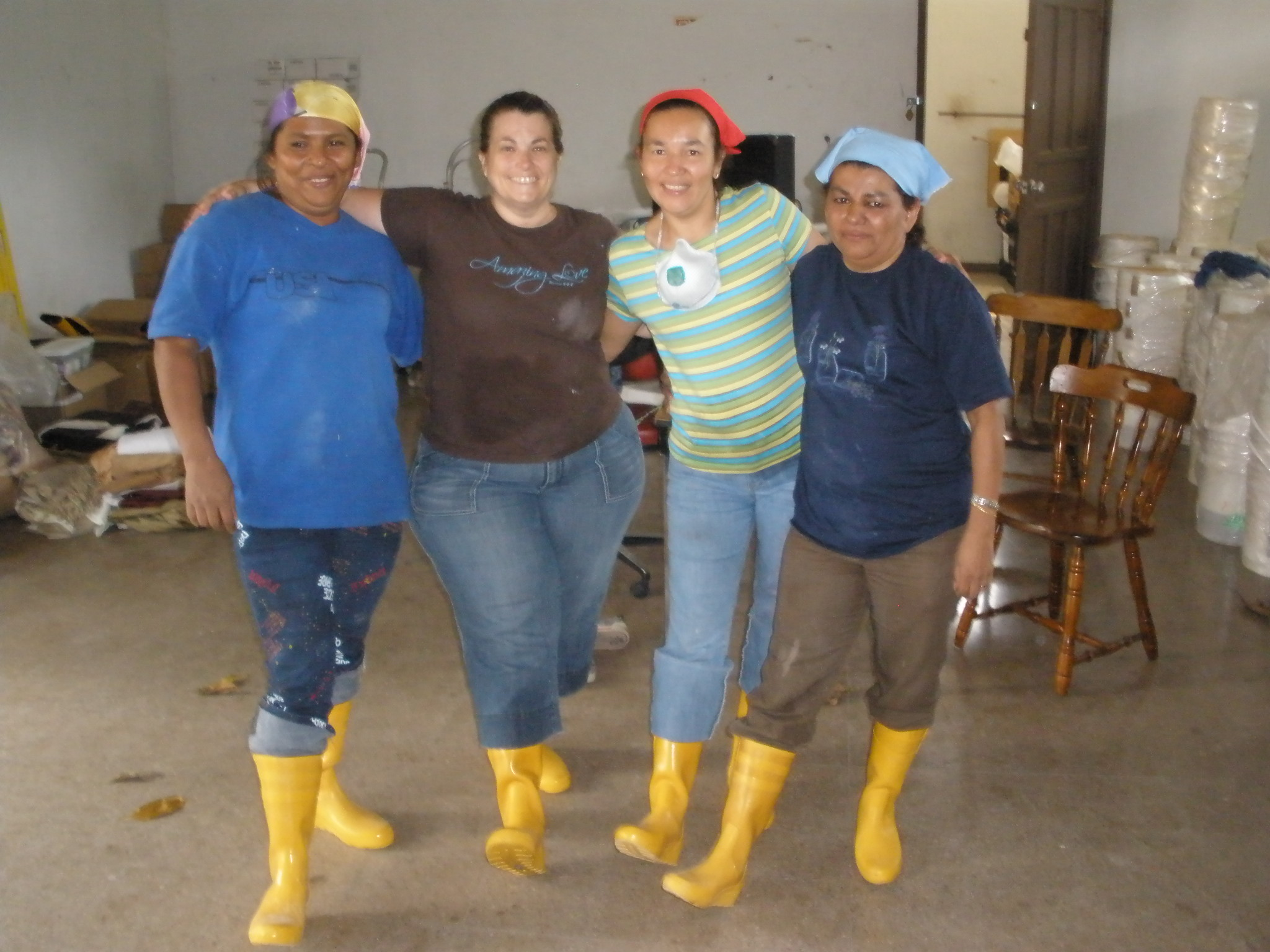 Founder Lori Connell, Cecila, Sonya and Maria working to renovate the new space.