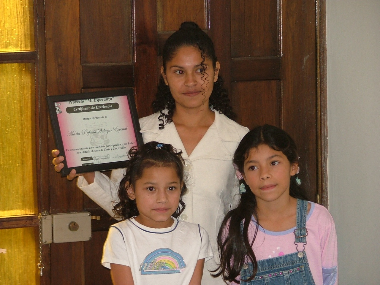 Level one graduation day with two of her daughters 2005