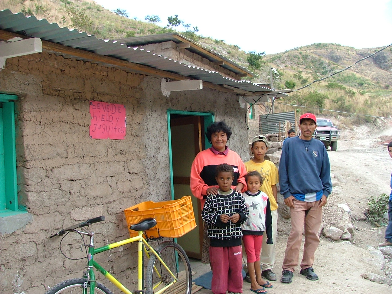 Hilda with her family in front of her house
