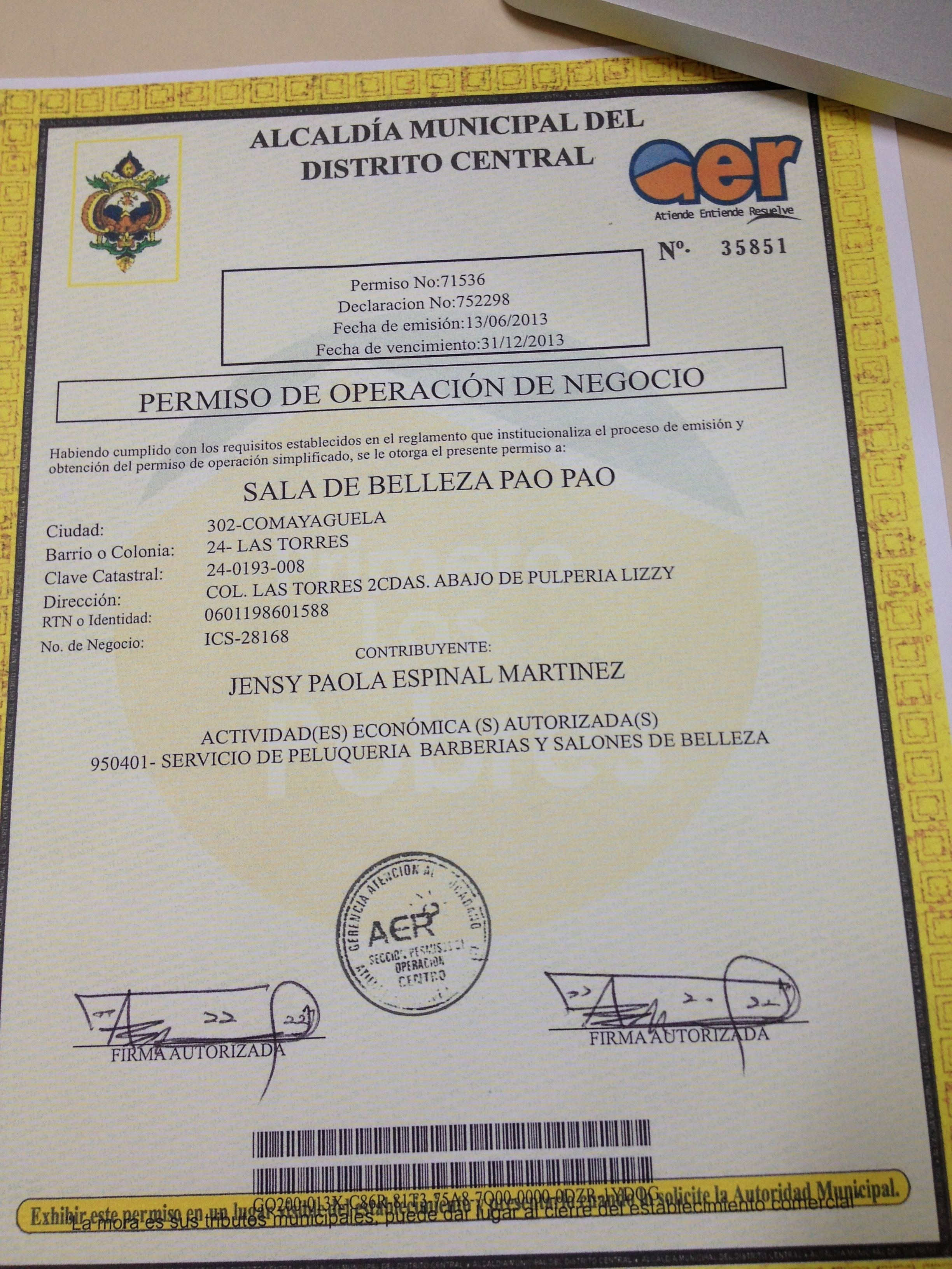 She is official! Paola's salon is registered and recognized my the government!
