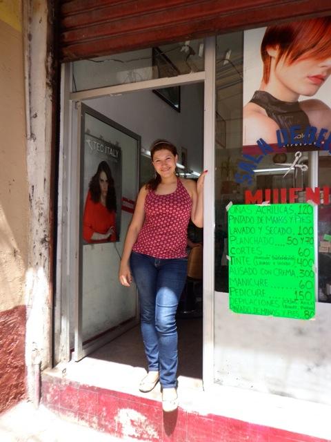Karen in front her Salon Millennium!