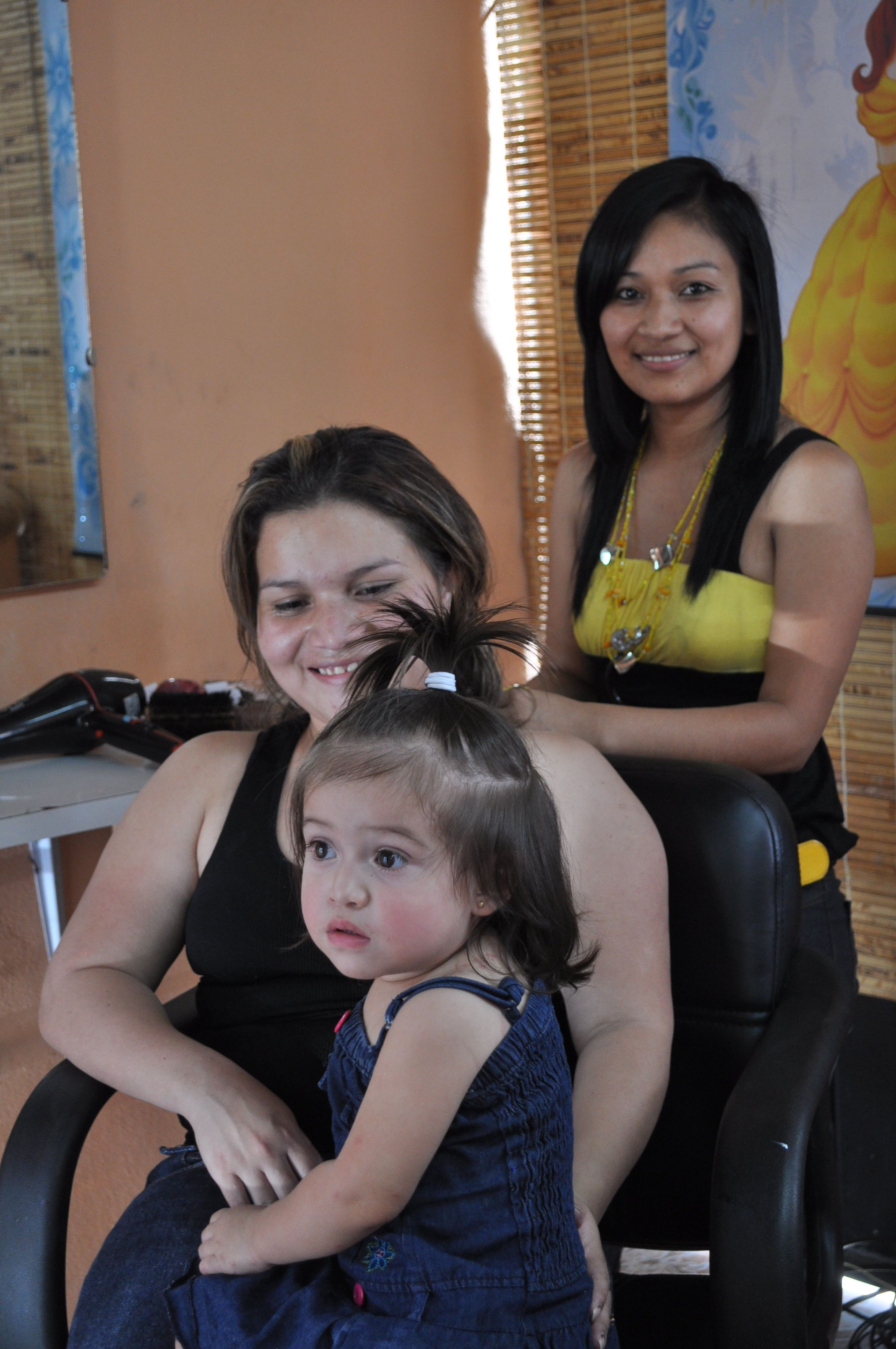 Working at her salon, Salon de Belleza Andreas
