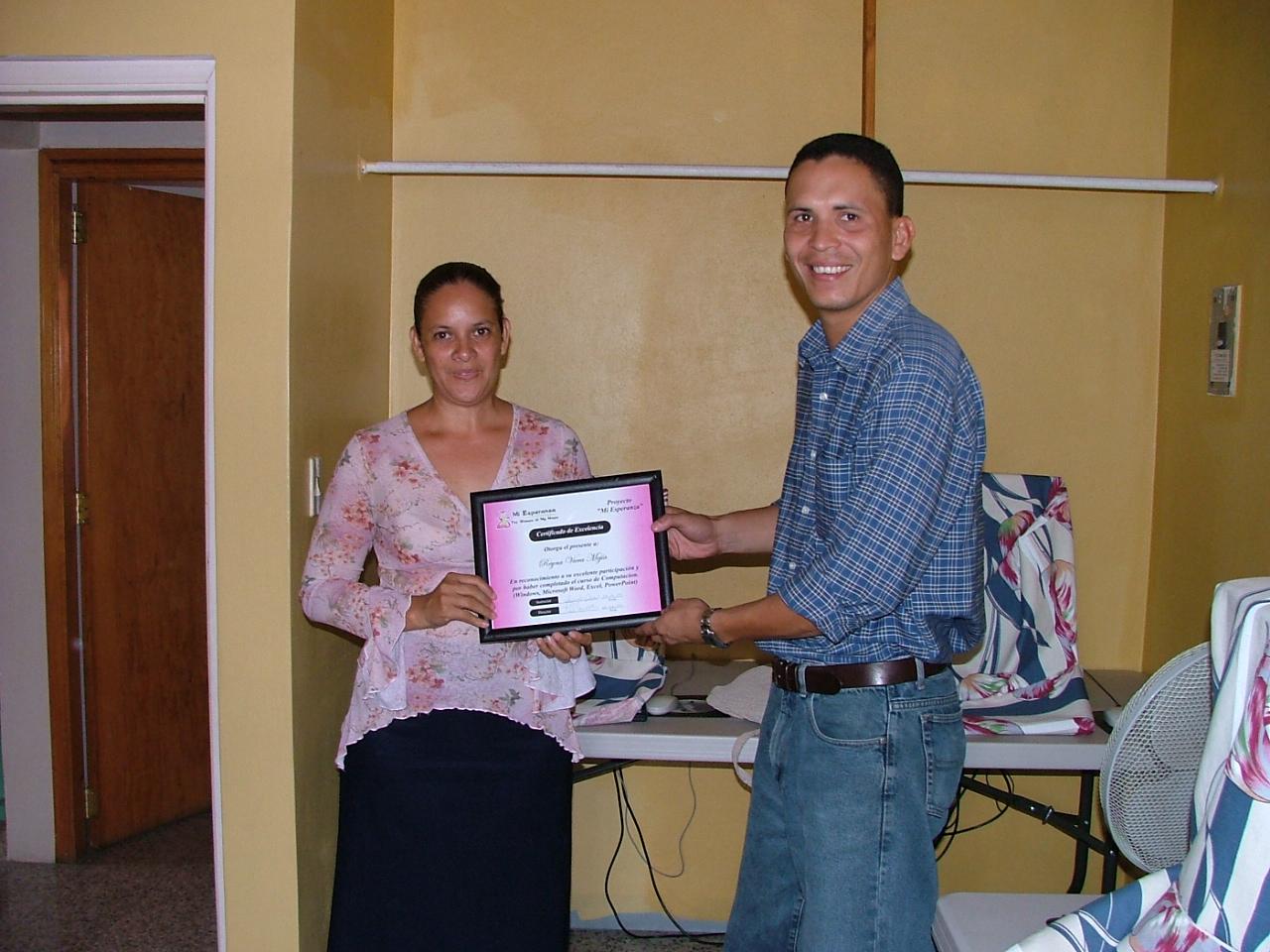 Reyna graduating from the Mi Esperanza computer course 2005