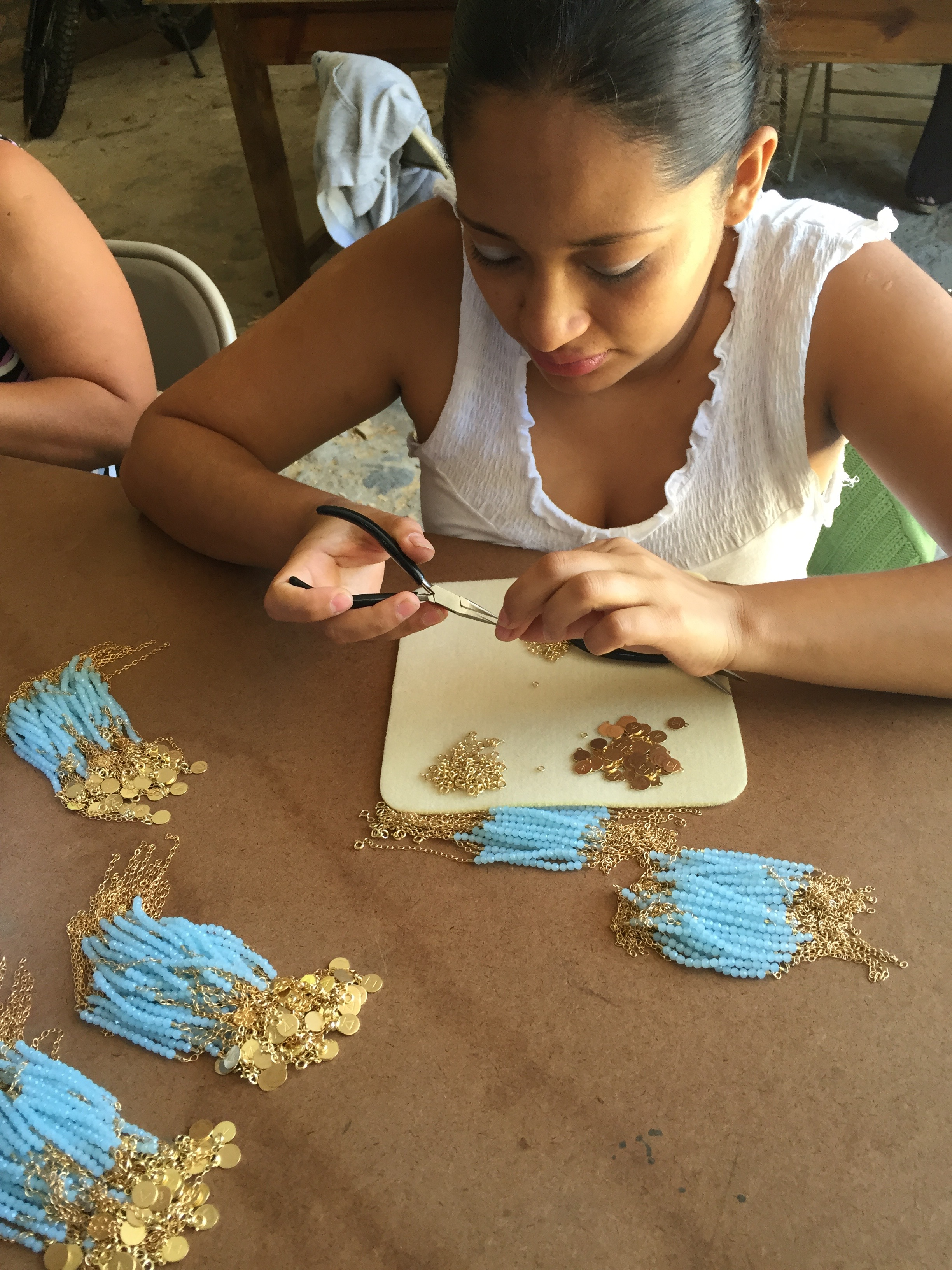 a jewelry artisan working on an 85,000 piece jewelry order for our partner in hope Tribe Alive for the Fab Fit Fun subscription box. Summer 2015