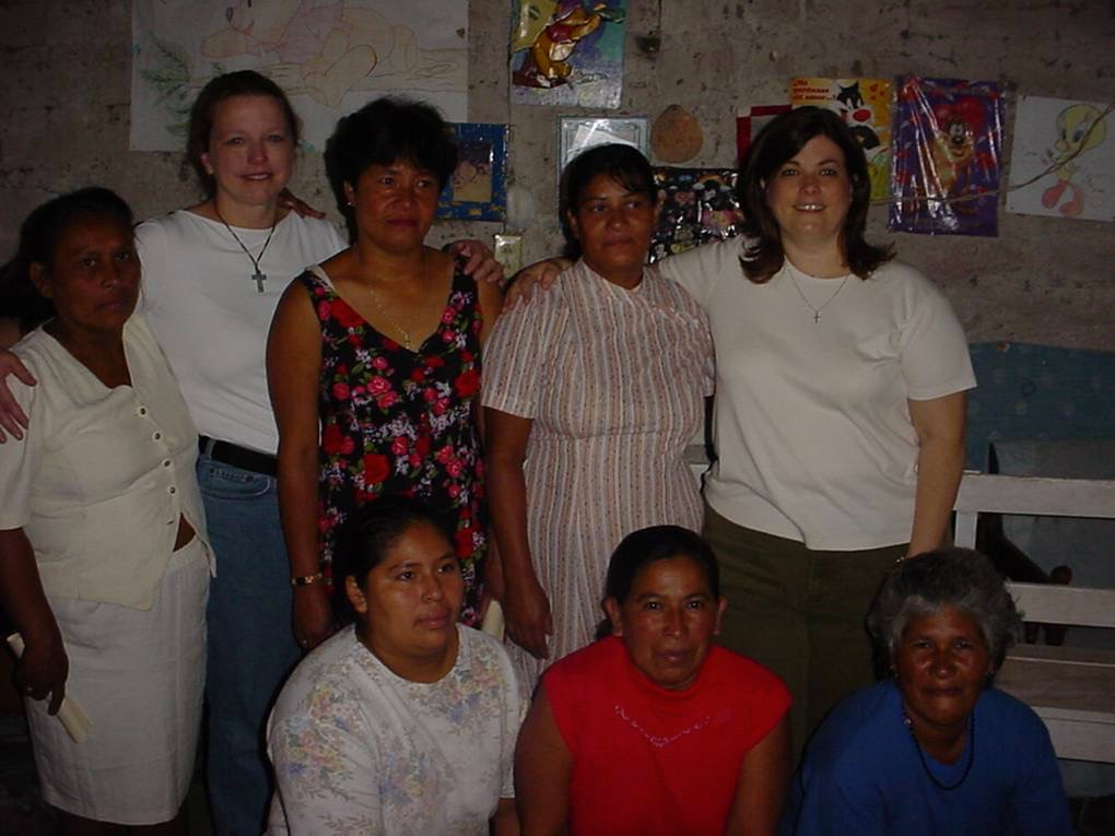 Founders Janet and Lori with the first six Mi Esperanza loan recipients (2002)