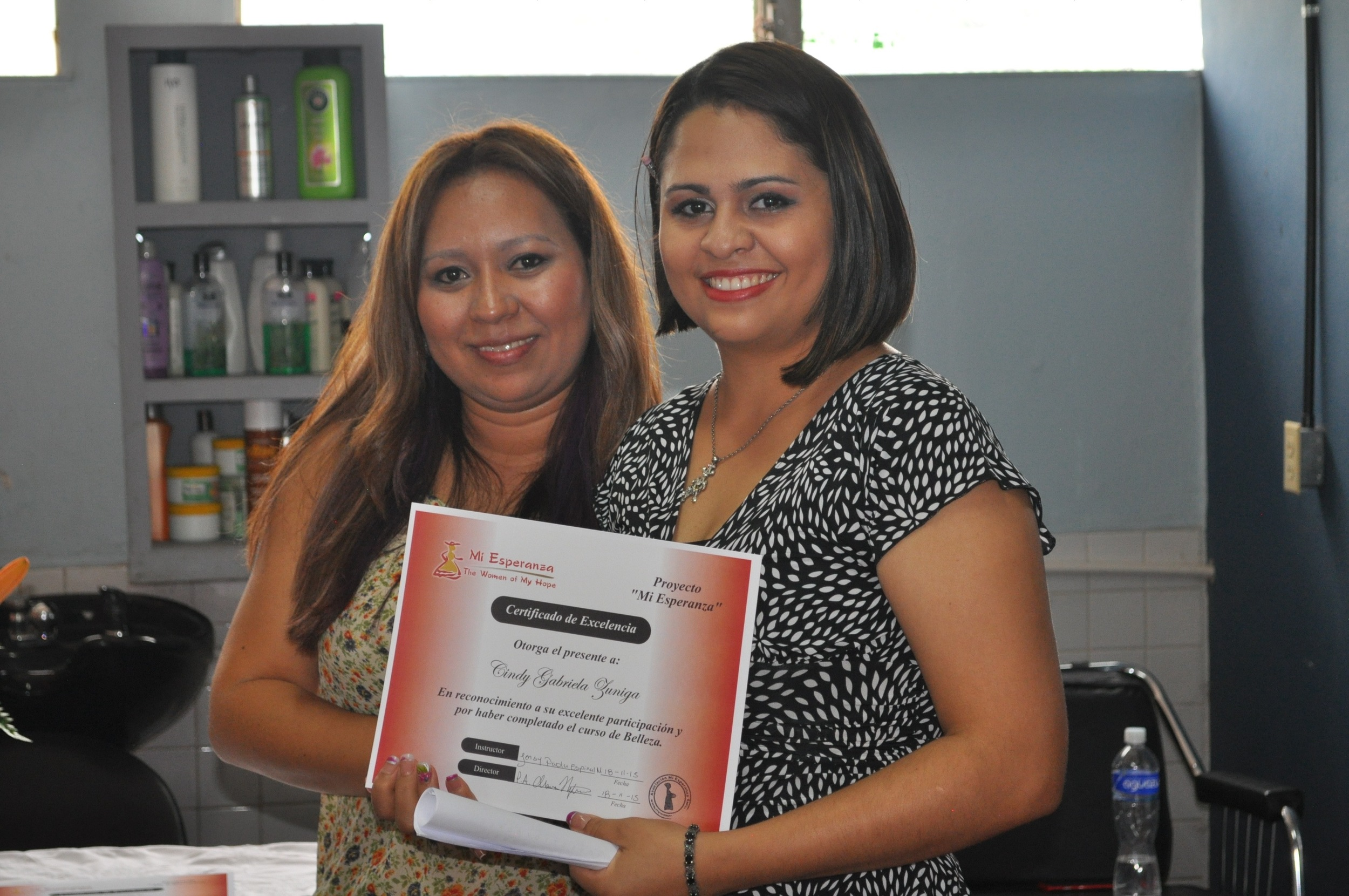 Paola (left) and one of her graduates