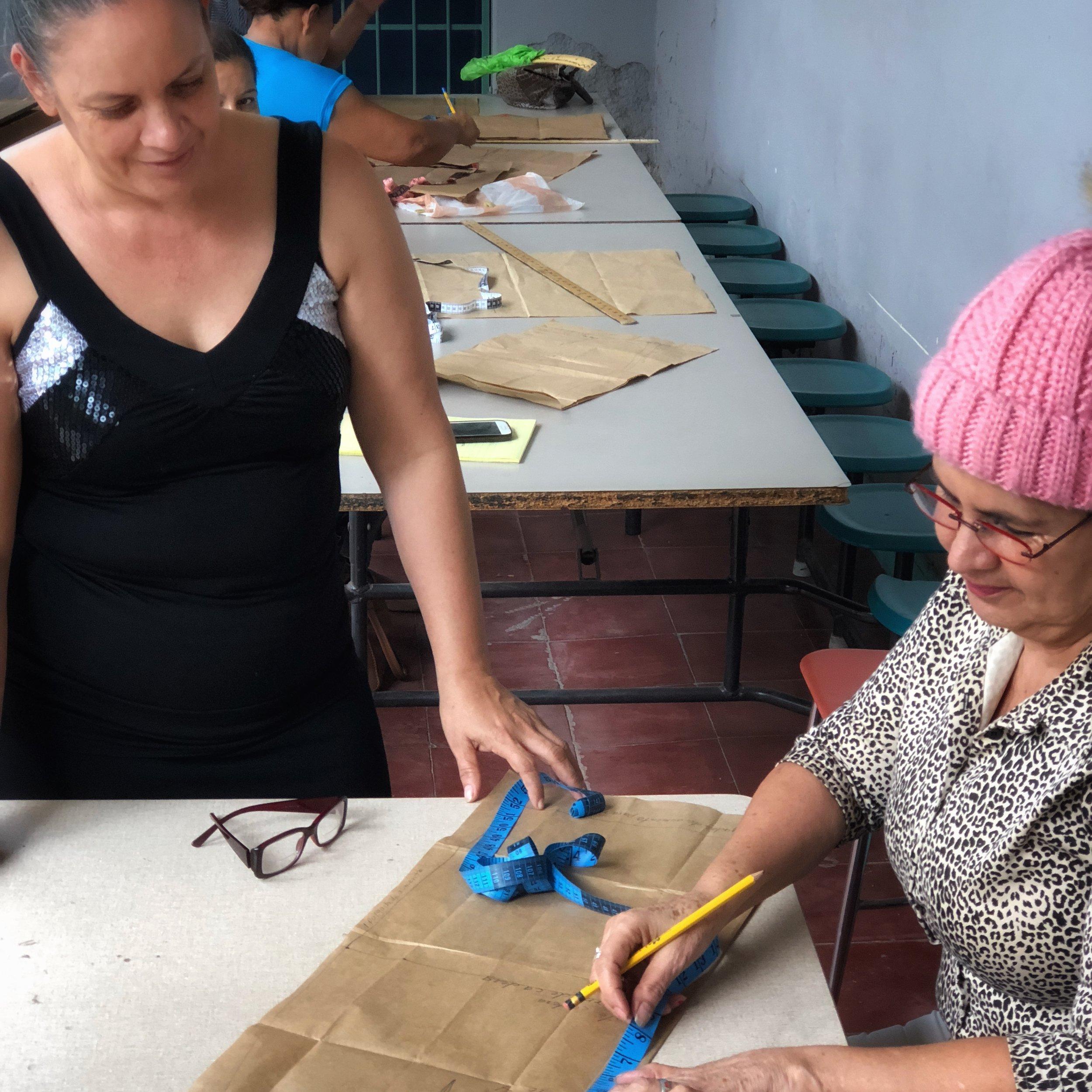 Reina teaching sewing class.jpeg