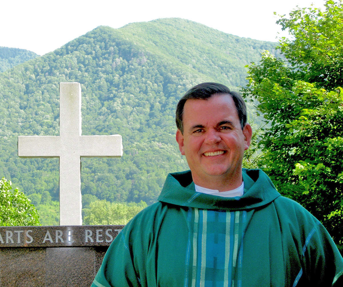 TEACHER OF FAITH — The faith community in Haywood County is mourning the passing of Fr. Jack Denny, O.S.A., who had a profound effect on the spiritual lives of the members of St. Margaret's Catholic Church, when he served as pastor. Fr. Denny is pictured on the church grounds in 2009.   Photo by: Carol Viau