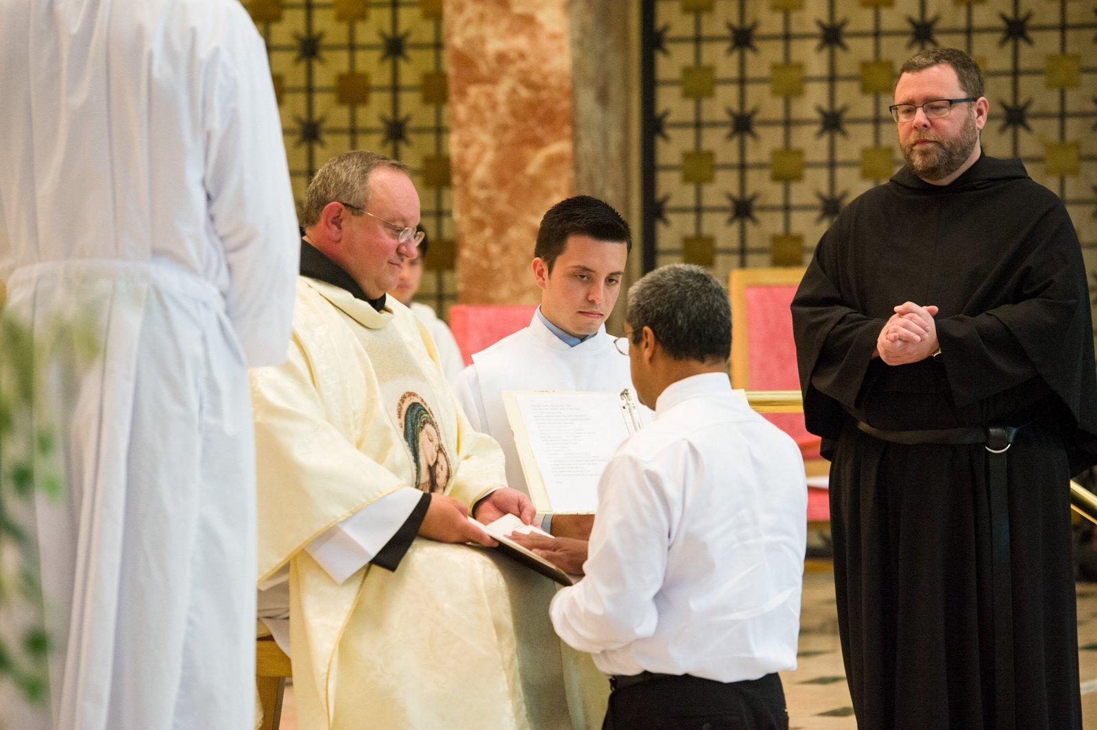 Fr. Joseph Broudou professes his first vows