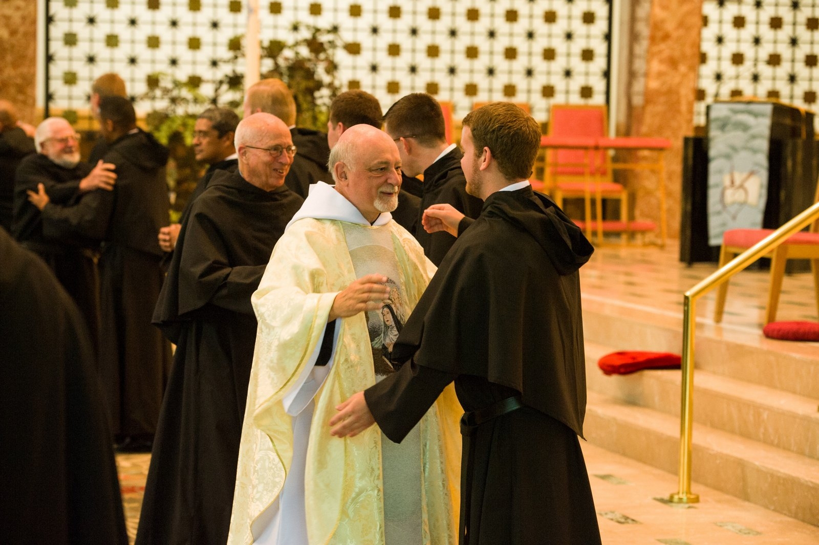 Friars then welcome newly professed with embrace