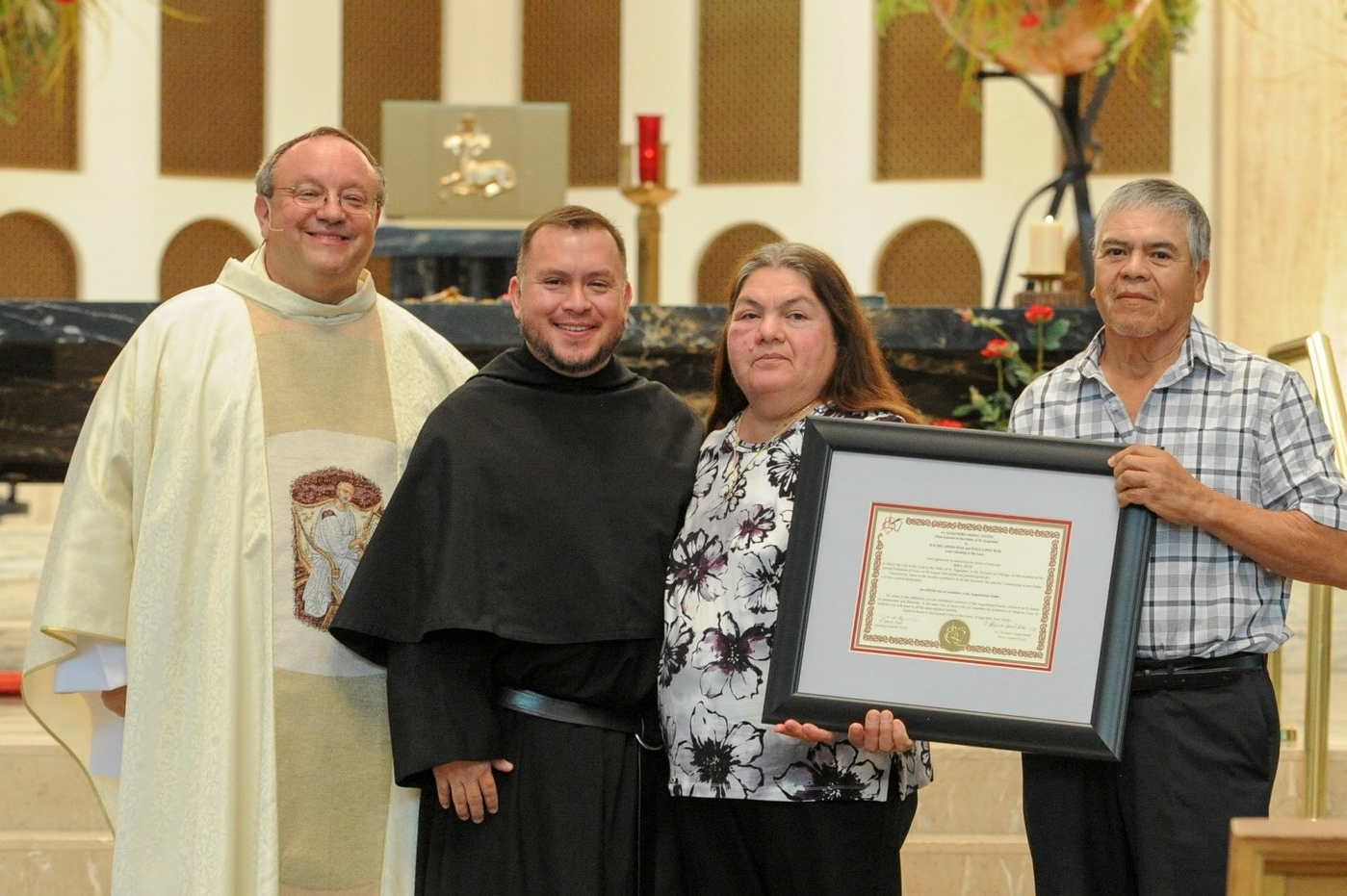 Brother Joe Ruiz, O.S.A., with his Provincial and newly affiliated parents