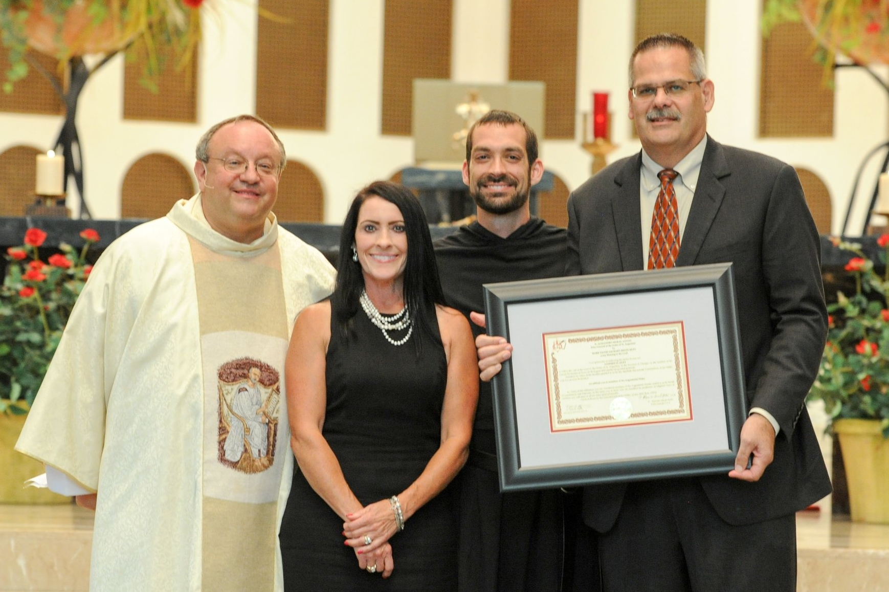 Brother Stephen Isley, O.S.A., with his Provincial and newly affiliated parents