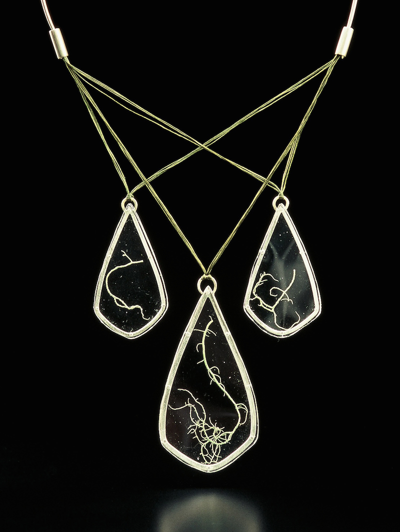 Three Tear Lichen Necklace: 2006   Developing a line for the first time, I began to put together pieces would be more wearable, yet still a large statement, at a lower cost. I explored non-precious materials, resulting in a few years of work with very little silver and gold. I really enjoyed the dynamics of the cord in this necklace, the sculptural patterns it creates when being worn.