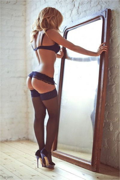 The basic bra-and-panties set gets an upgrade with a pair of black stockings and black heels that will make your legs look incredibly long and sexy. This is an example of a classic boudoir outfit.