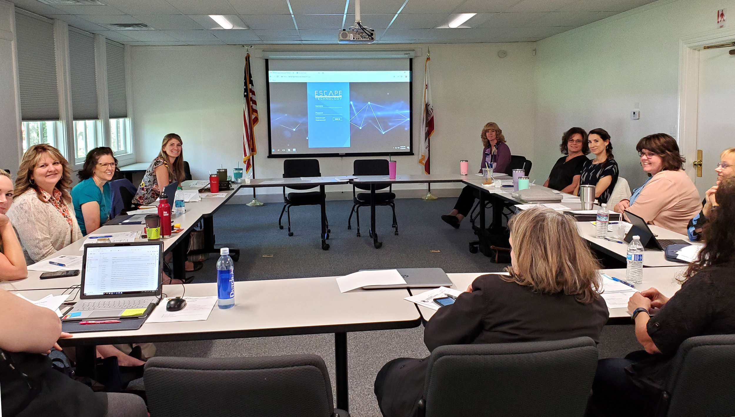 Business Services Meeting at Tehama CDE where the CBO's are viewing Escape Employee Online Portal's new release and look.