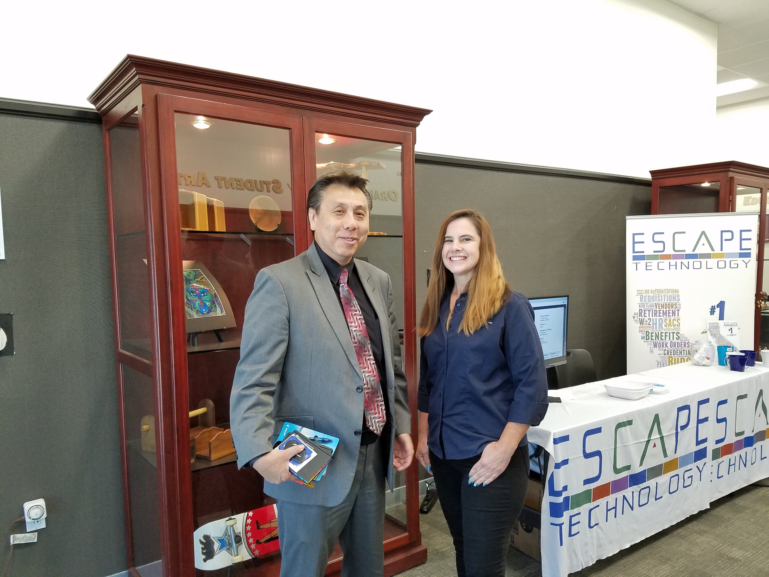 Carl Fong, Chief Technology Officer, OCDE, and Kathy Carlson, Escape Senior Project Manager, chat about the latest school business news.