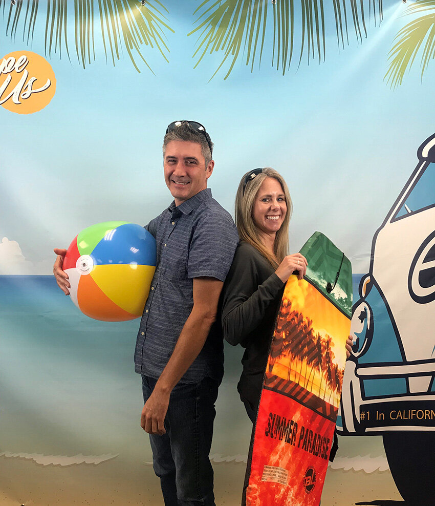 Kirk Hamman, Sr. UI/UX Designer, and Jennifer Escamilla, Escape Product Manager, get ready for the Online 6 beach party!