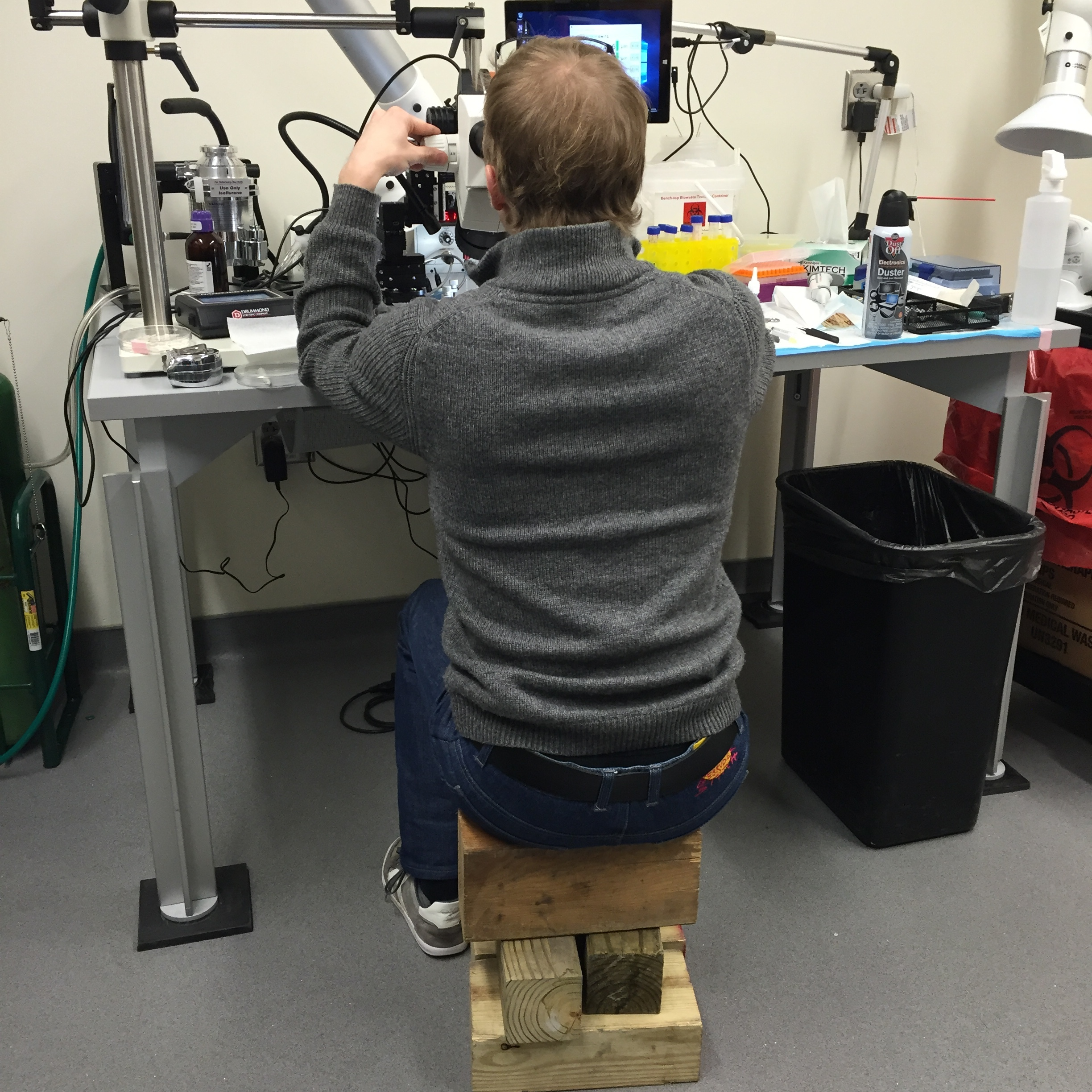 High tech seating solution to angled surgical scope eyepieces.