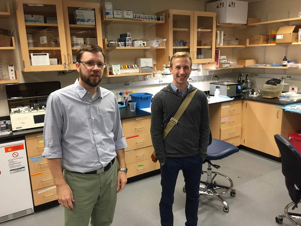 Showing Lukas around his new lab.