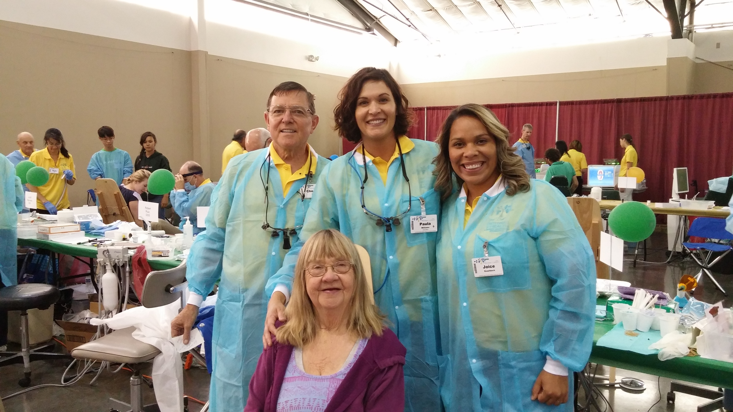 Volunteers and one happy patient at Pathway to Health 2015.