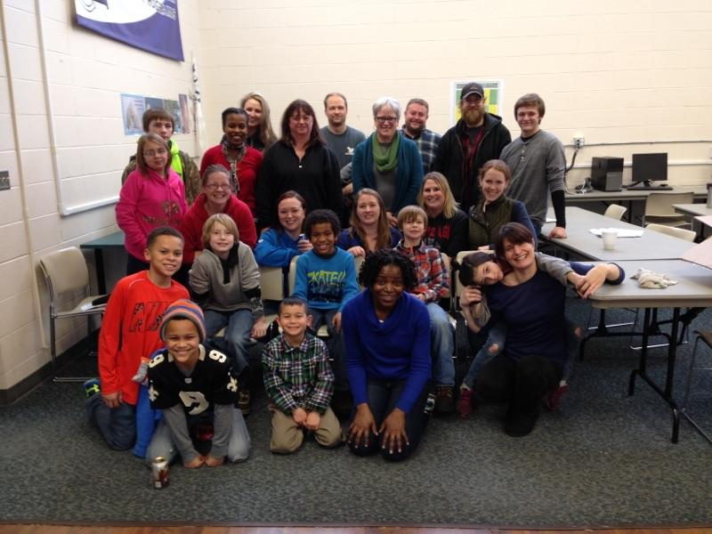 EHF, BHT, and FIN staff pose for a photo with local youth volunteering at East Central Community Center.
