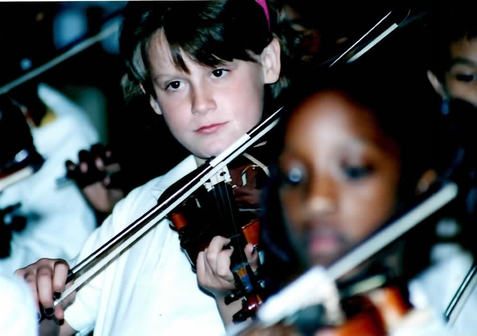 Students at Most Holy Trinity took violin lessons in the flagship arts education program in the St. Louis area