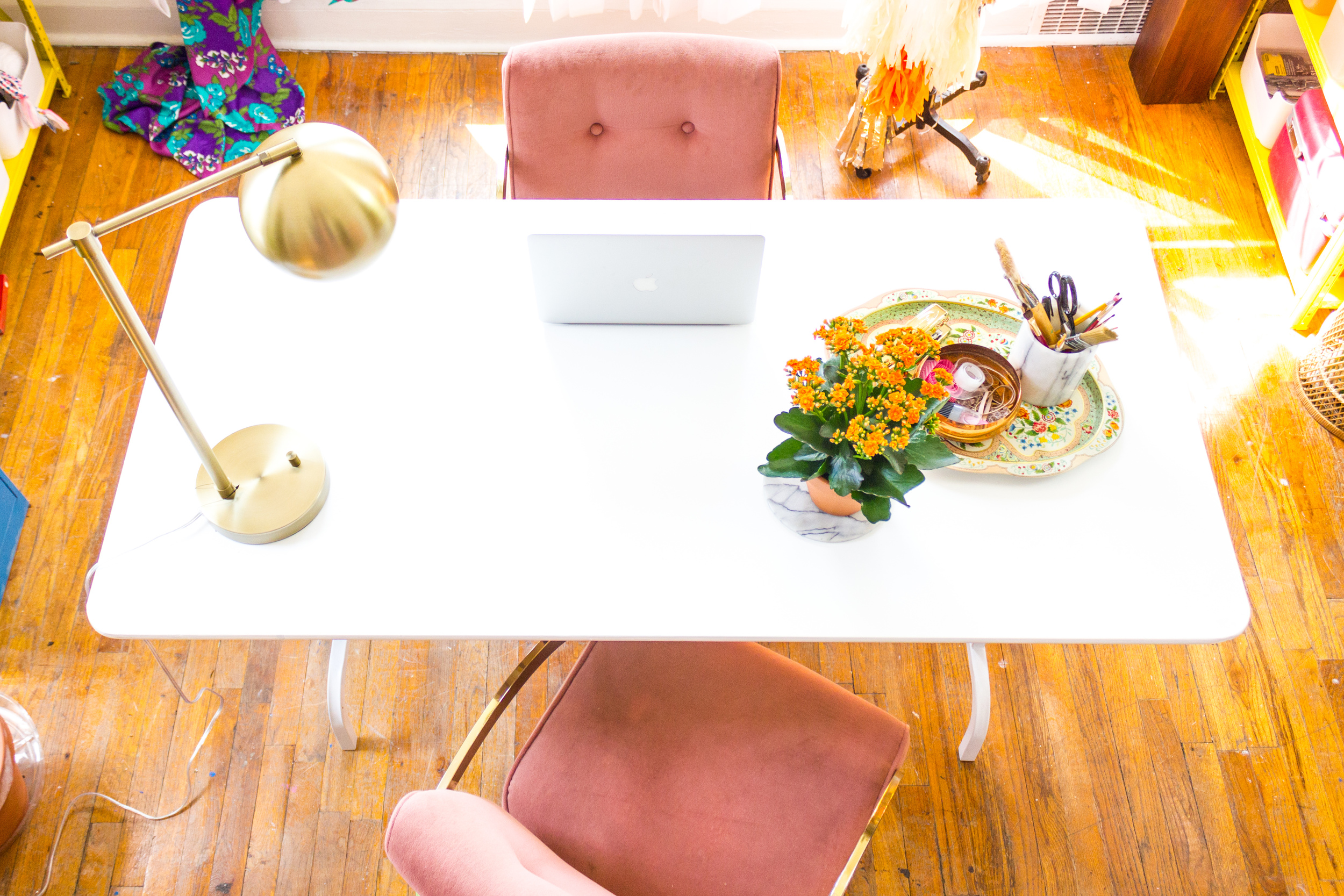 Bright, Brass and Colorful Workspace with White Desk
