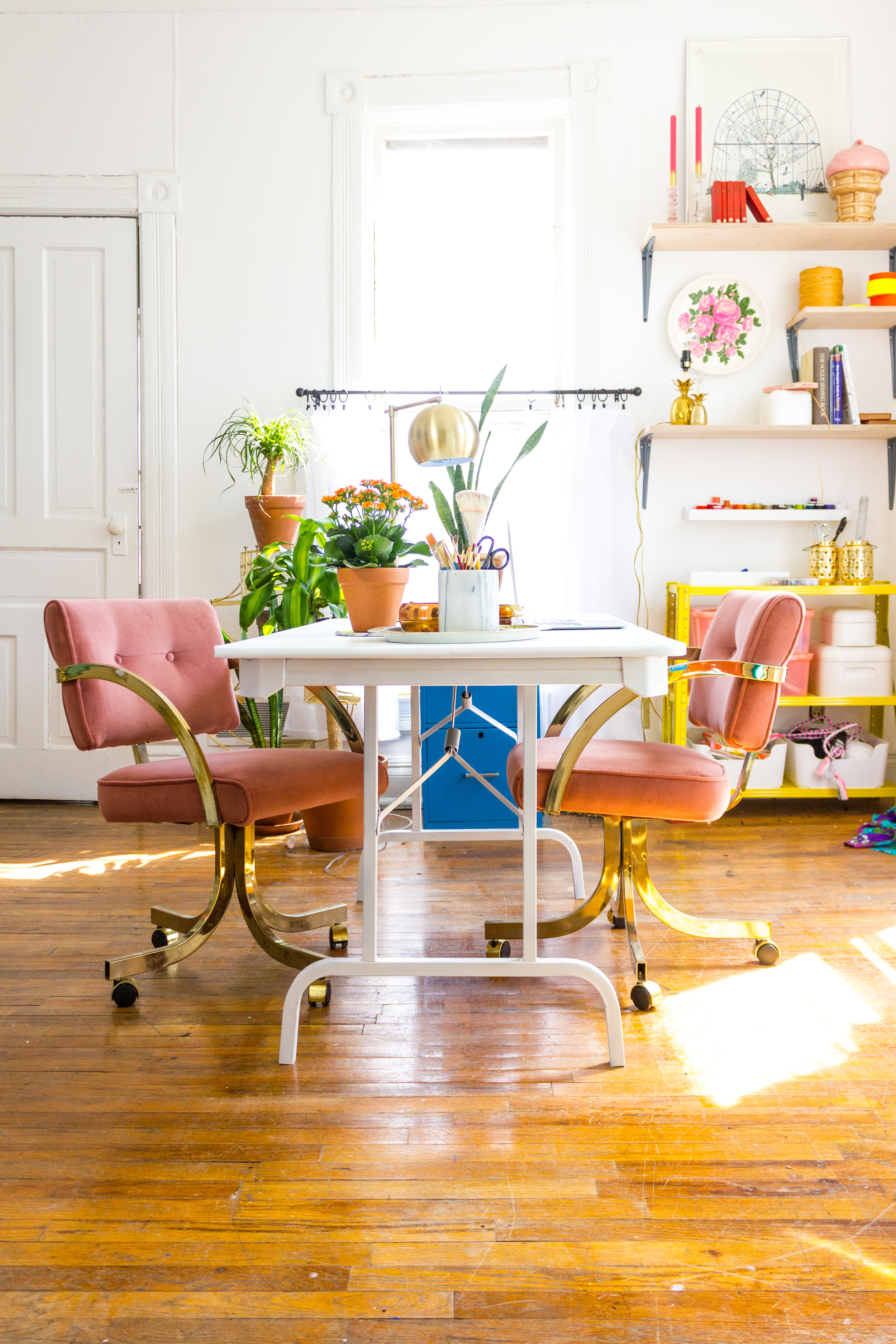 Bright, Brass, and Colorful Workspace with White Desk