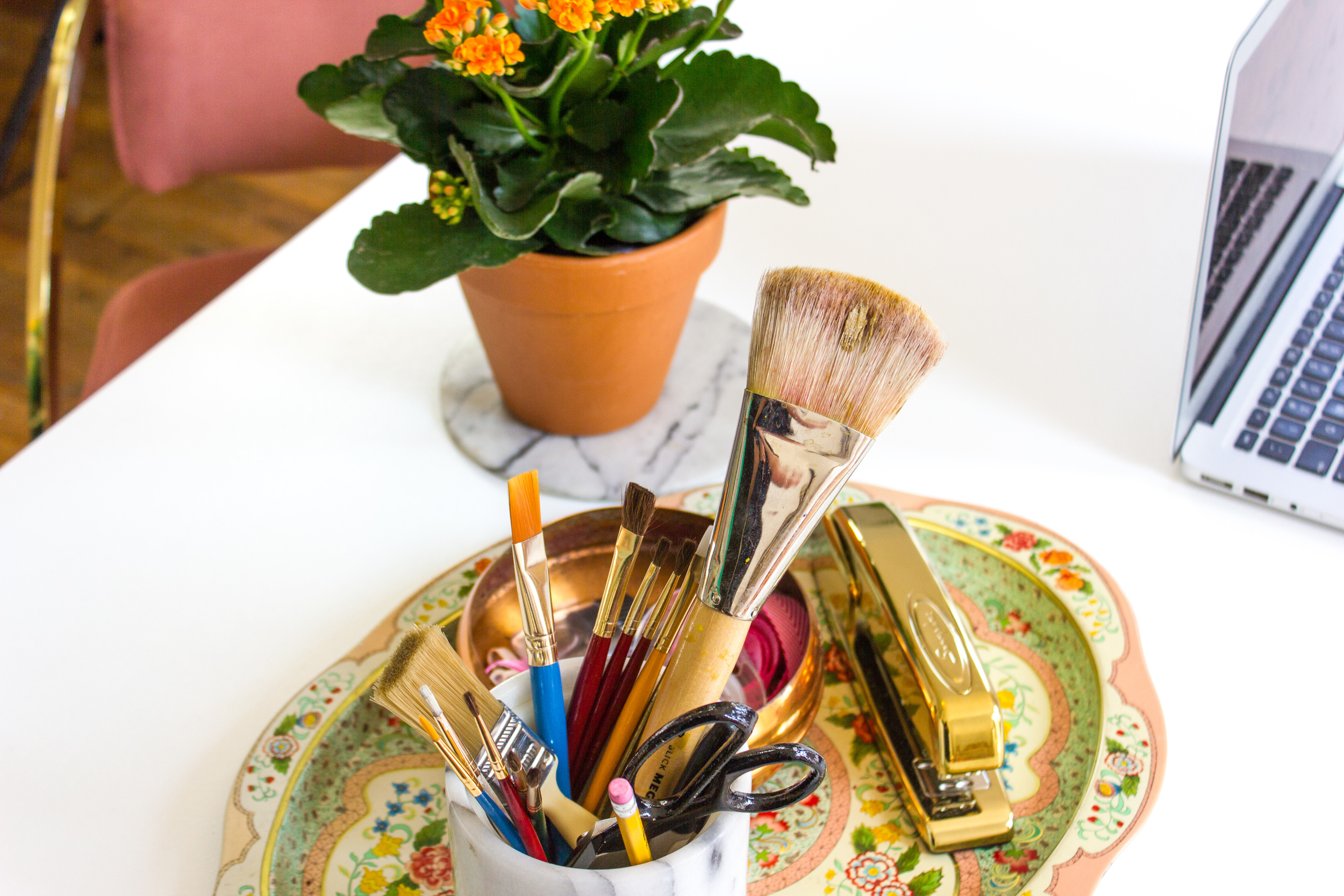 Bright, Brass, and Colorful Workspace