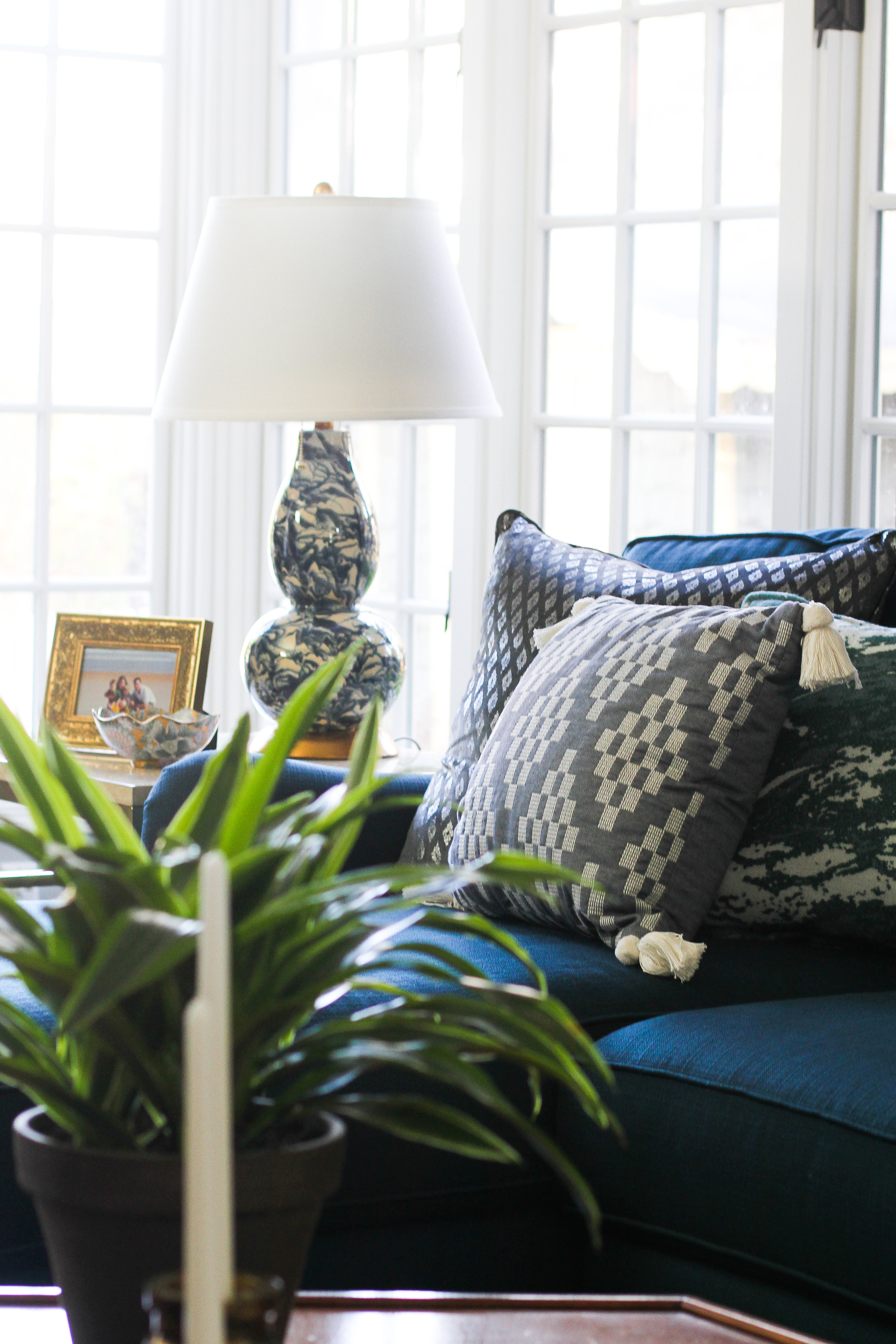 Blue Family Room with Marble lamp and Corner Windows