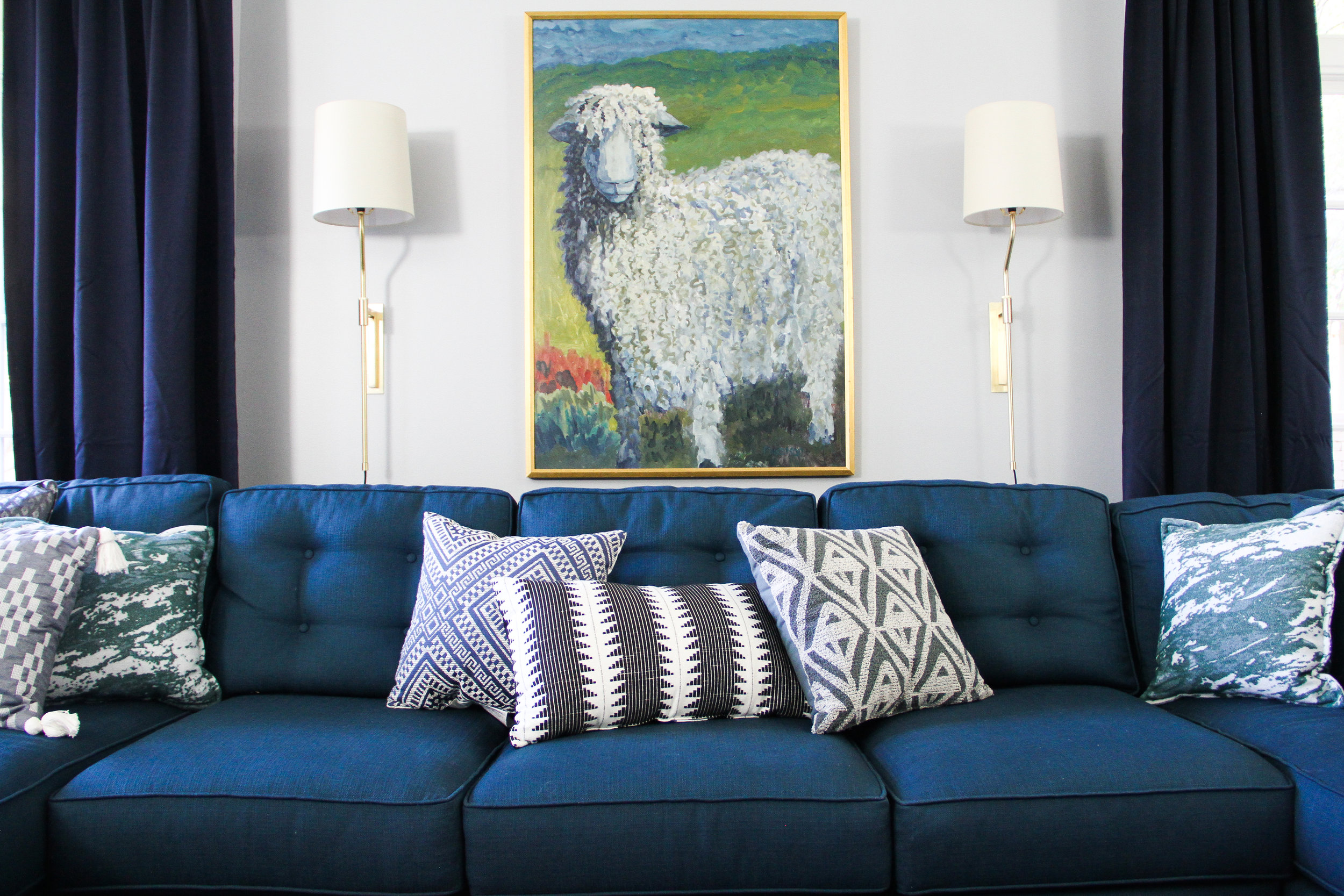Blue Traditional Family Room with Brass Sconces and Quirky Sheep Oil Painting