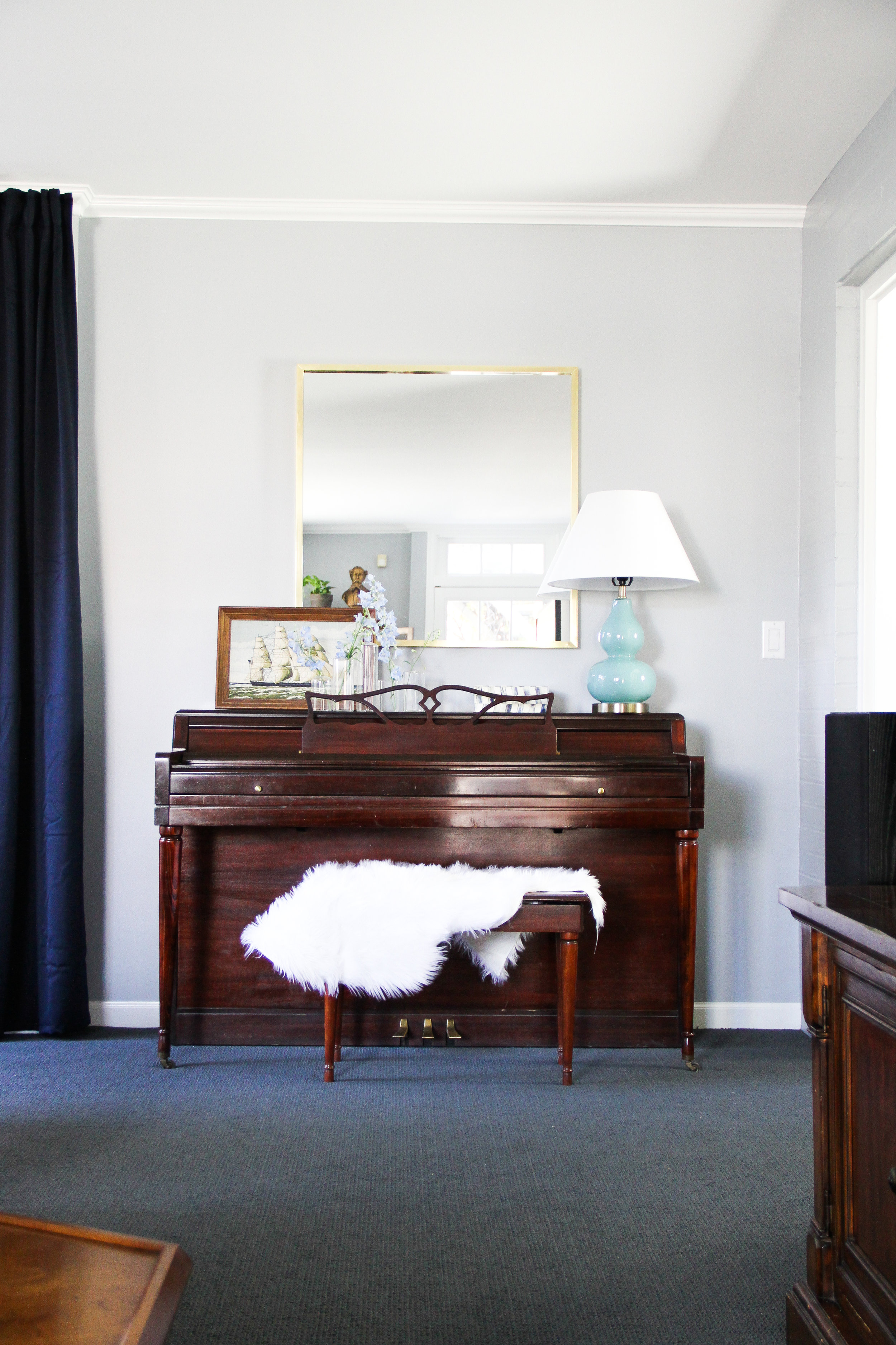 Blue Traditional Family Room with Piano and Brass Square Mirror