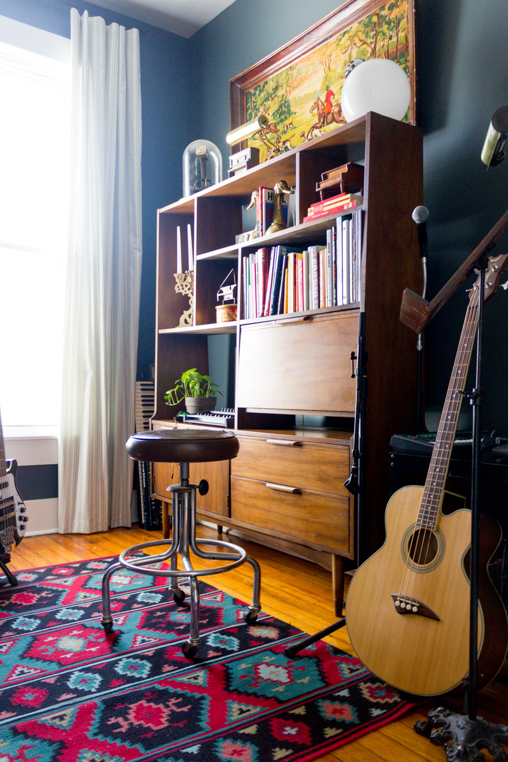 Navy in-home music studio with vintage rug