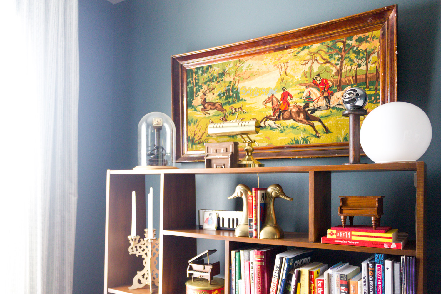 Navy in-home music studio with vintage hunting scene art