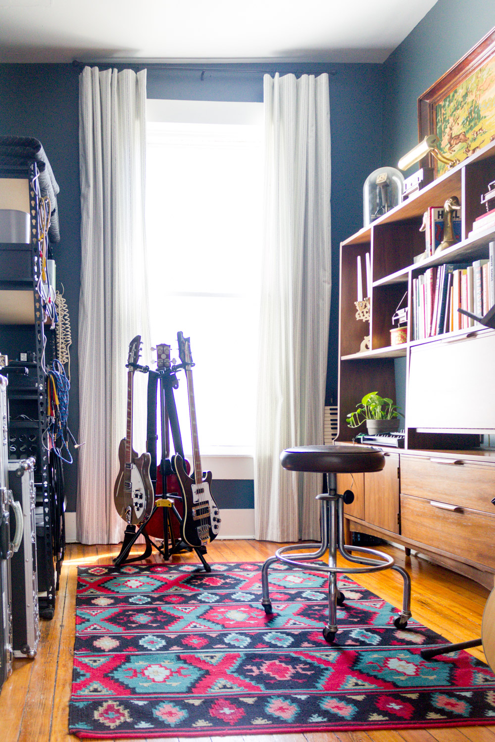 Navy in-home music studio with vintage gear