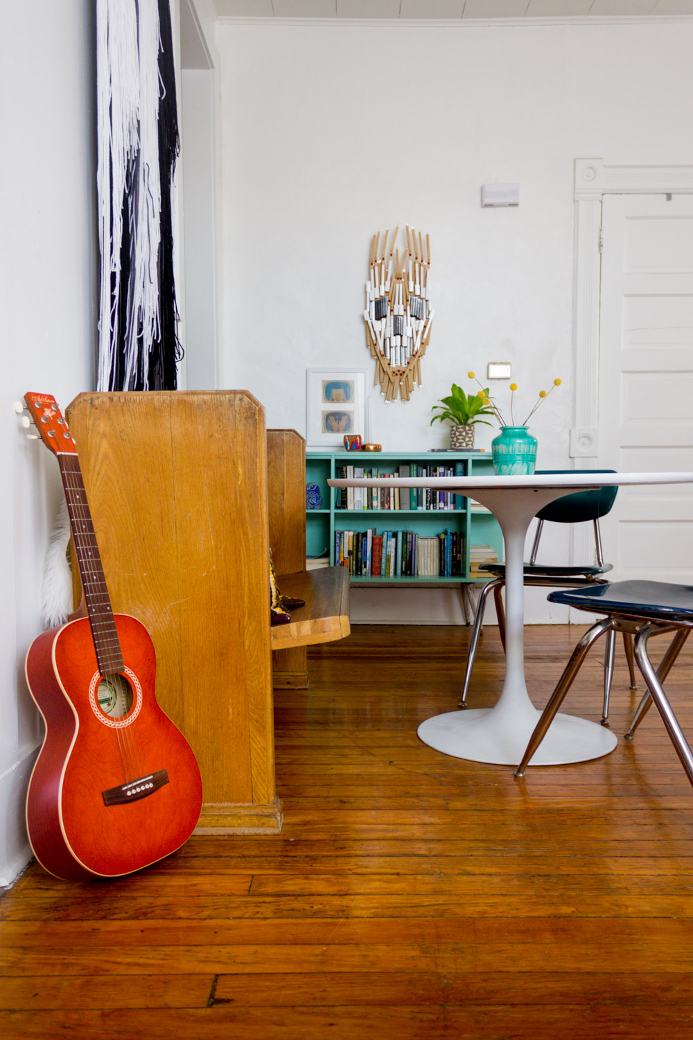 Colorful in-home music studio with tulip table
